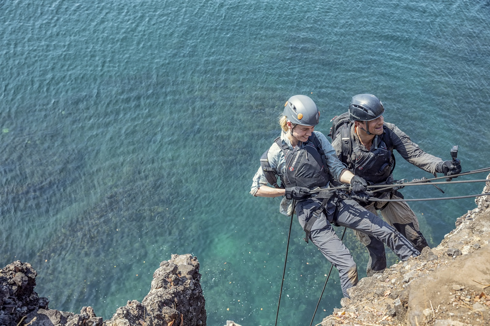 Panama - (L to R) Brie Larson and Bear Grylls rappel down a sheer drop-off for National Geographic's RUNNING WILD WITH BEAR GRYLLS. (National Geographic/Ben Simms)
