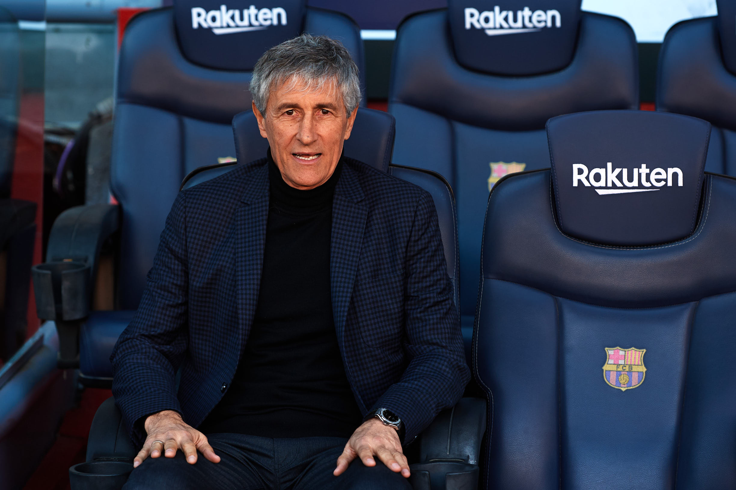 BARCELONA, SPAIN - JANUARY 14: FC Barcelona Head Coach Quique Setien sits on the bench and poses for the media as he is unveiled as new FC Barcelona Coach at Camp Nou on January 14, 2020 in Barcelona, Spain. (Photo by Alex Caparros/Getty Images)