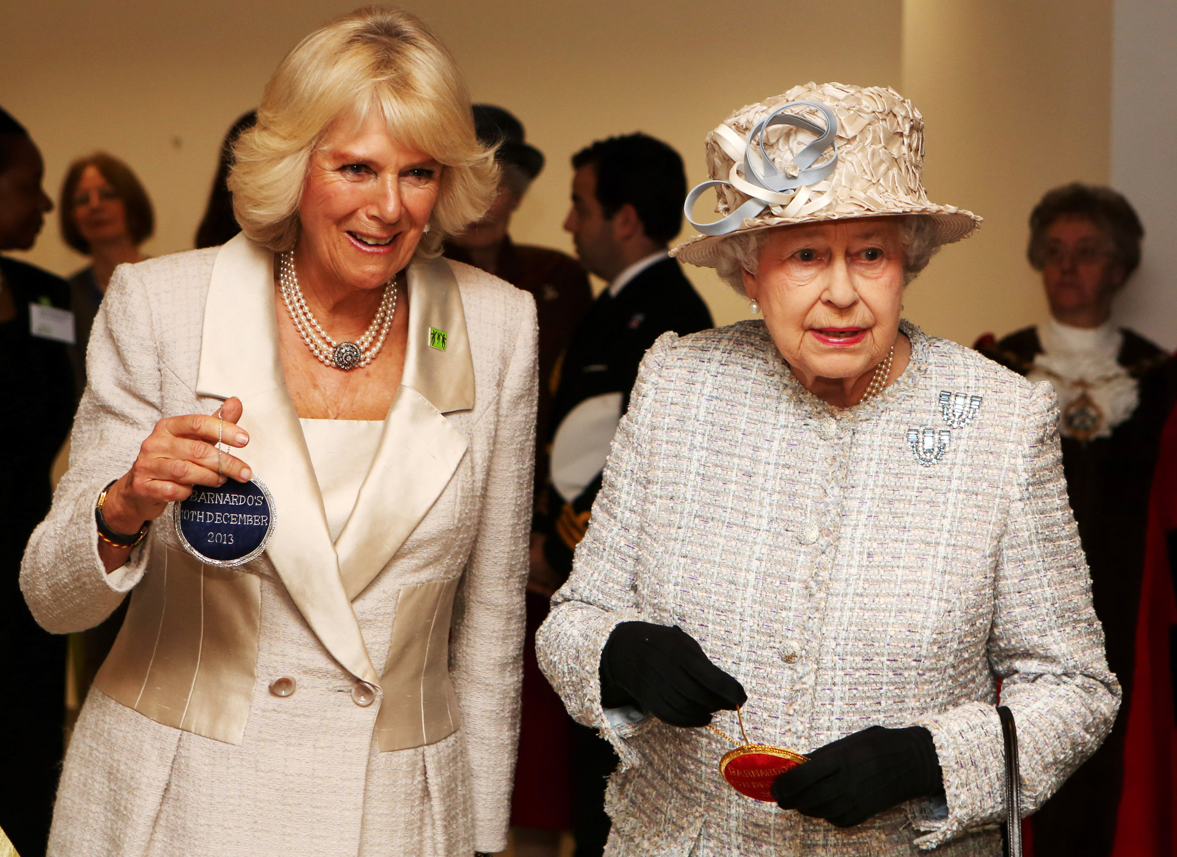 LONDON, ENGLAND - DECEMBER 10:  Camilla, Duchess of Cornwall and Queen Elizabeth II visit the new Barnardo's HQ in Barkingside on December 10, 2013 in London, England.  (Photo by Chris Radburn - WPA Pool/Getty Images)