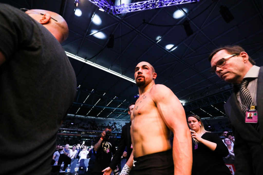 A defeated Robert Whittaker of Australia leaves the octagon after being defeated by Israel Adesanya of New Zealand during the middleweight title bout of the UFC 243 fight night in Melbourne on October 6, 2019. (Photo by ASANKA BRENDON RATNAYAKE / AFP) / -- IMAGE RESTRICTED TO EDITORIAL USE - STRICTLY NO COMMERCIAL USE --