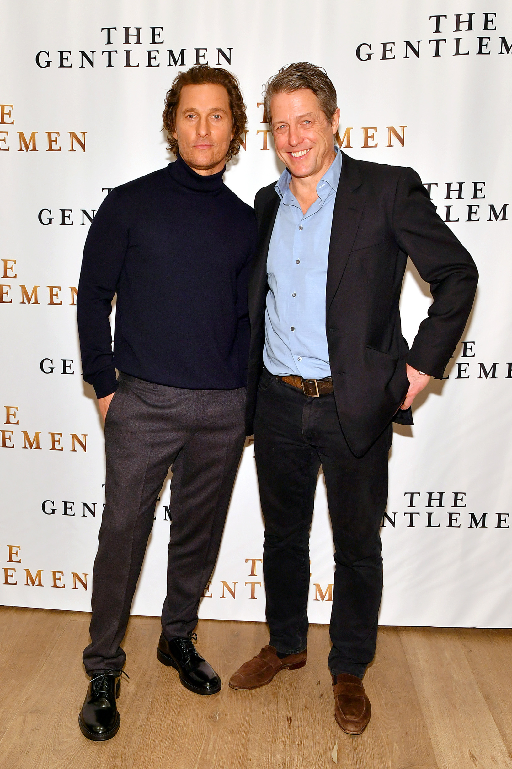 NEW YORK, NEW YORK - JANUARY 11: Matthew McConaughey (L) and Hugh Grant attend the NY Photo Call for
