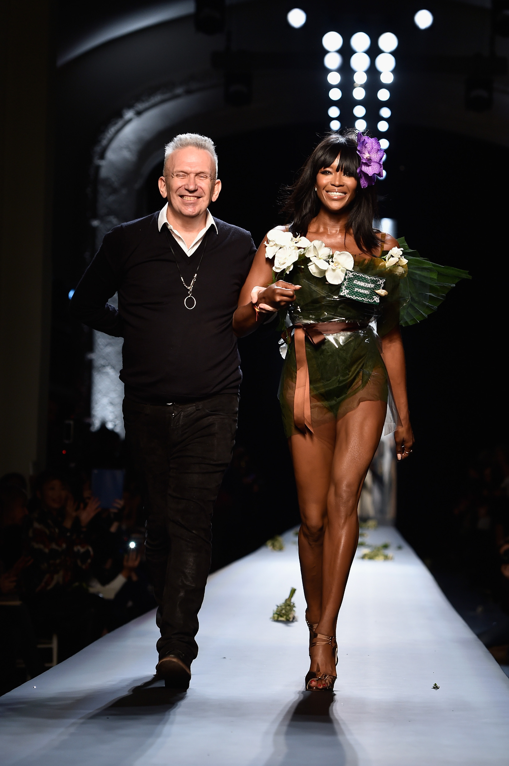 PARIS, FRANCE - JANUARY 28:  (L-R) Fashion designer Jean Paul Gaultier and model Naomi Campbell walk the runway at the end of the Jean Paul Gaultier show as part of Paris Fashion Week Haute Couture Spring/Summer 2015 on January 28, 2015 in Paris, France.  (Photo by Pascal Le Segretain/Getty Images)