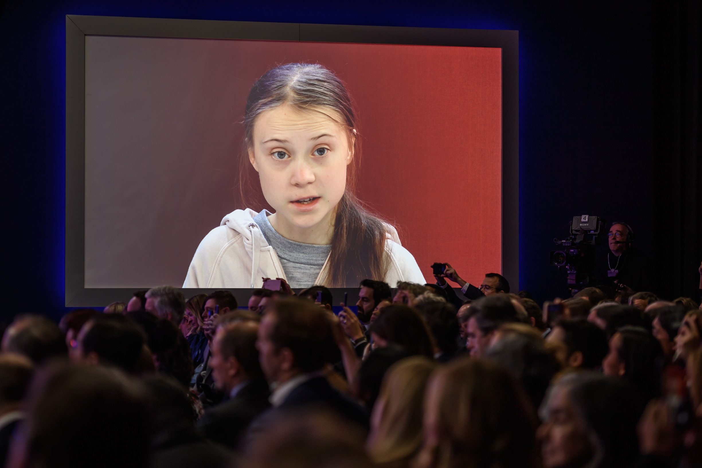 Swedish climate activist Greta Thunberg attends a session at the Congres center during the World Economic Forum (WEF) annual meeting in Davos, on January 21, 2020. (Photo by Fabrice COFFRINI / AFP)