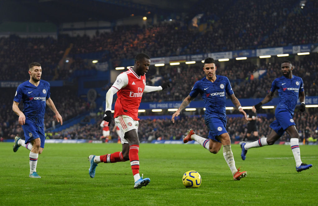 LONDON, ENGLAND - JANUARY 21: Nicolas Pepe of Arsenal is put under pressure by Mateo Kovacic, Emerson Palmieri and Antonio Rudiger of Chelsea during the Premier League match between Chelsea FC and Arsenal FC at Stamford Bridge on January 21, 2020 in London, United Kingdom. (Photo by Mike Hewitt/Getty Images)