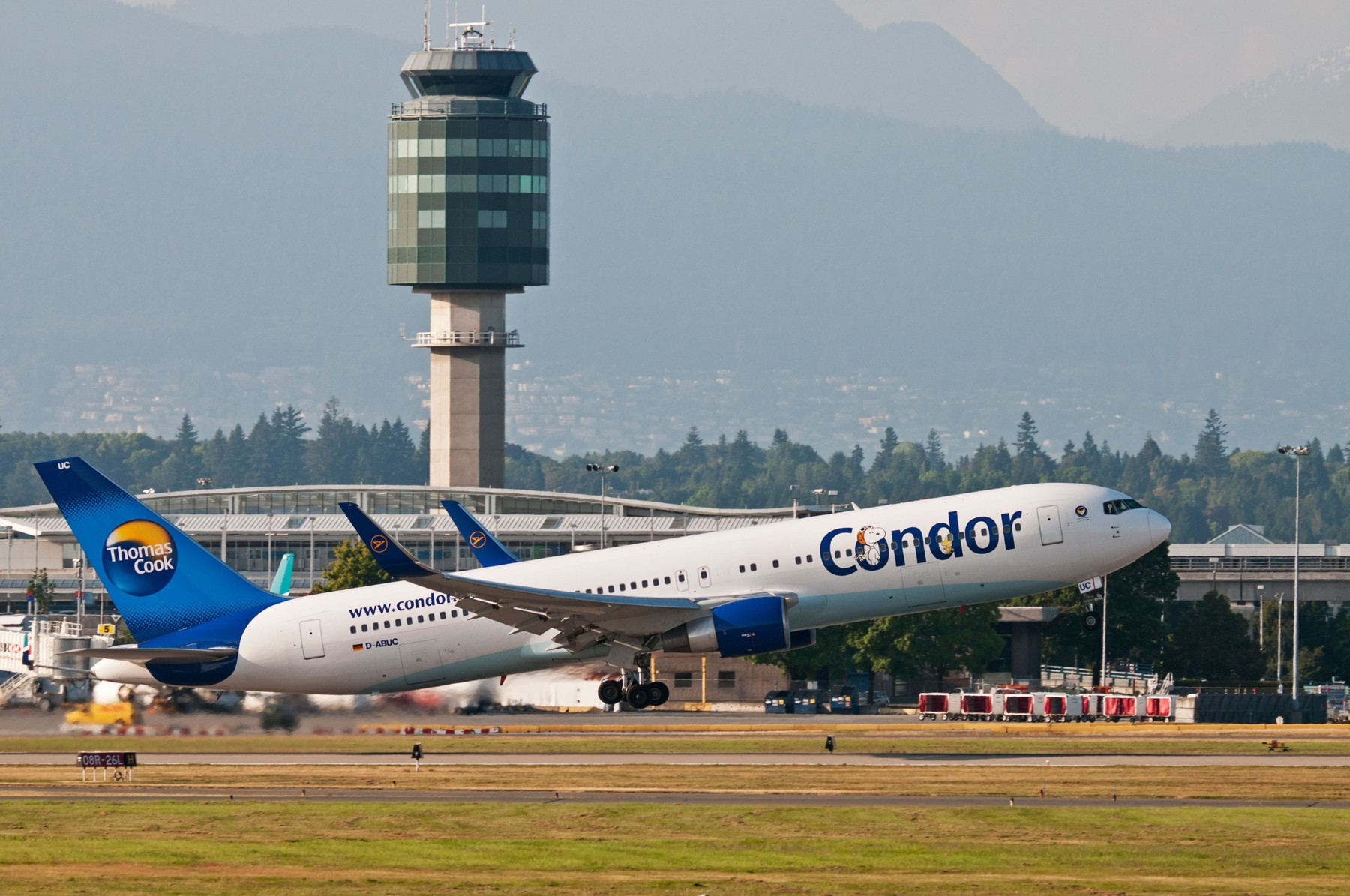 A Condor (Thomas Cook) Boeing 757 jetliner takes off from Vancouver International Airport. The airport's distinctive control tower can be seen in the background., Image: 121041691, License: Rights-managed, Restrictions: , Model Release: no, Credit line: Bayne Stanley / Alamy / Alamy / Profimedia