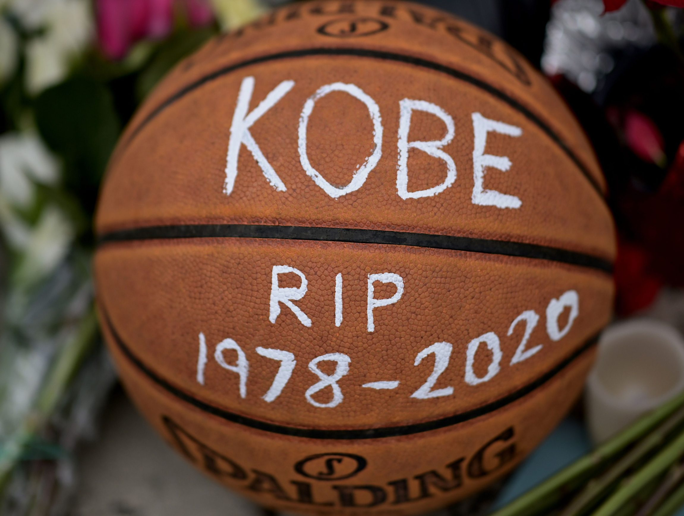 Basketballs are seen outside Bryant Gymnasium at Lower Merion High School, where basketball legend Kobe Bryant formally attended school, after his passing, on January 27, 2020 in Philadelphia, Pennsylvania. - Nine people were killed in the helicopter crash which claimed the life of NBA star Kobe Bryant and his 13 year old daughter, Los Angeles officials confirmed on Sunday. Los Angeles County Sheriff Alex Villanueva said eight passengers and the pilot of the aircraft died in the accident. The helicopter crashed in foggy weather in the Los Angeles suburb of Calabasas. Authorities said firefighters received a call shortly at 9:47 am about the crash, which caused a brush fire on a hillside. (Photo by Johannes EISELE / AFP)