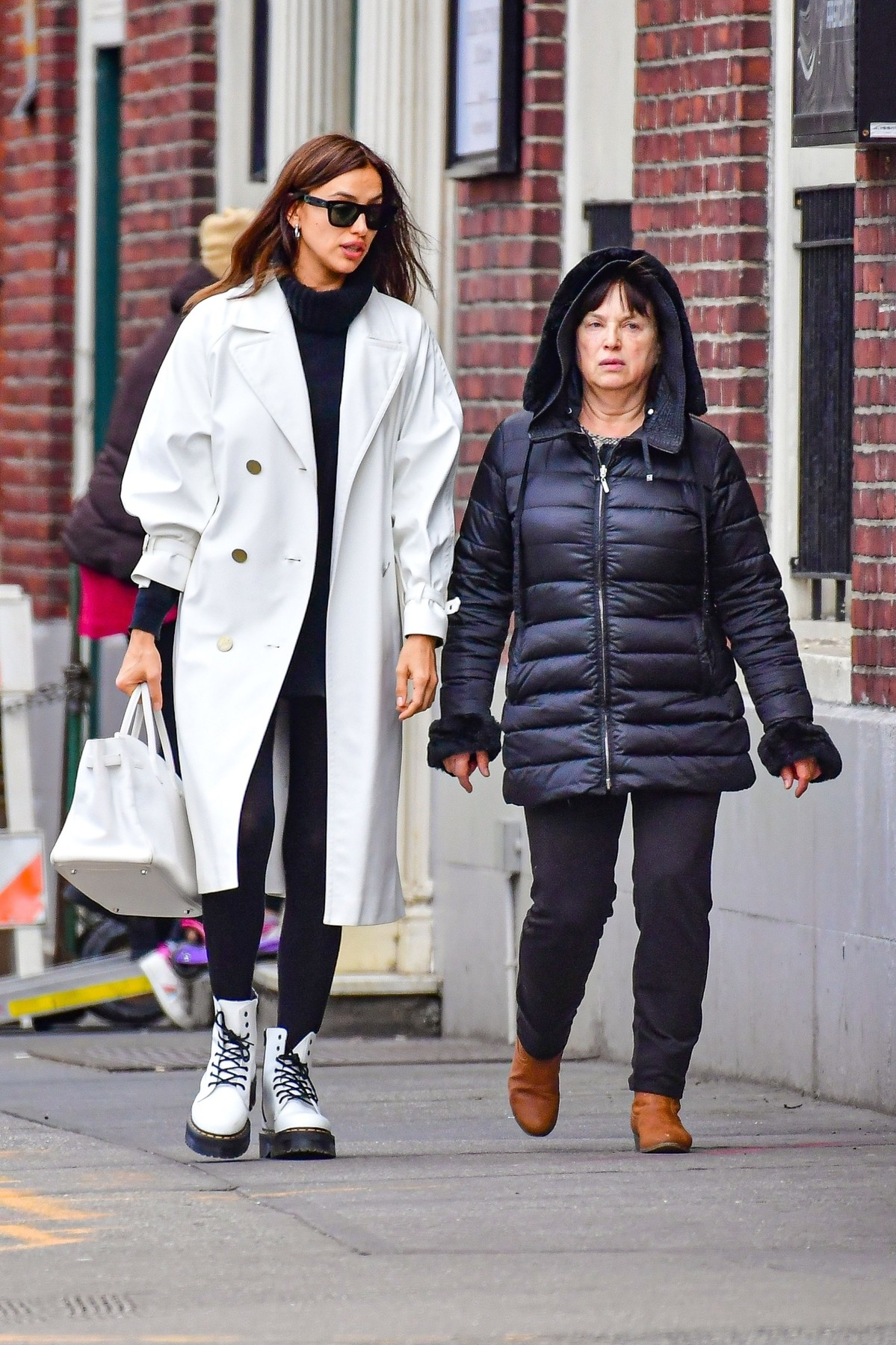 New York, Ny  - *EXCLUSIVE*  - Irina Shayk looks happy while shopping with her mother Olga Shaykhlislamova. Irina stands out in a large white trench coat, black turtleneck, black leggings, and white and black boots.  BACKGRID USA 27 JANUARY 2020, Image: 495079667, License: Rights-managed, Restrictions: RIGHTS: WORLDWIDE EXCEPT IN FRANCE, GERMANY, POLAND, Model Release: no, Credit line: Skyler2018 / BACKGRID / Backgrid USA / Profimedia
