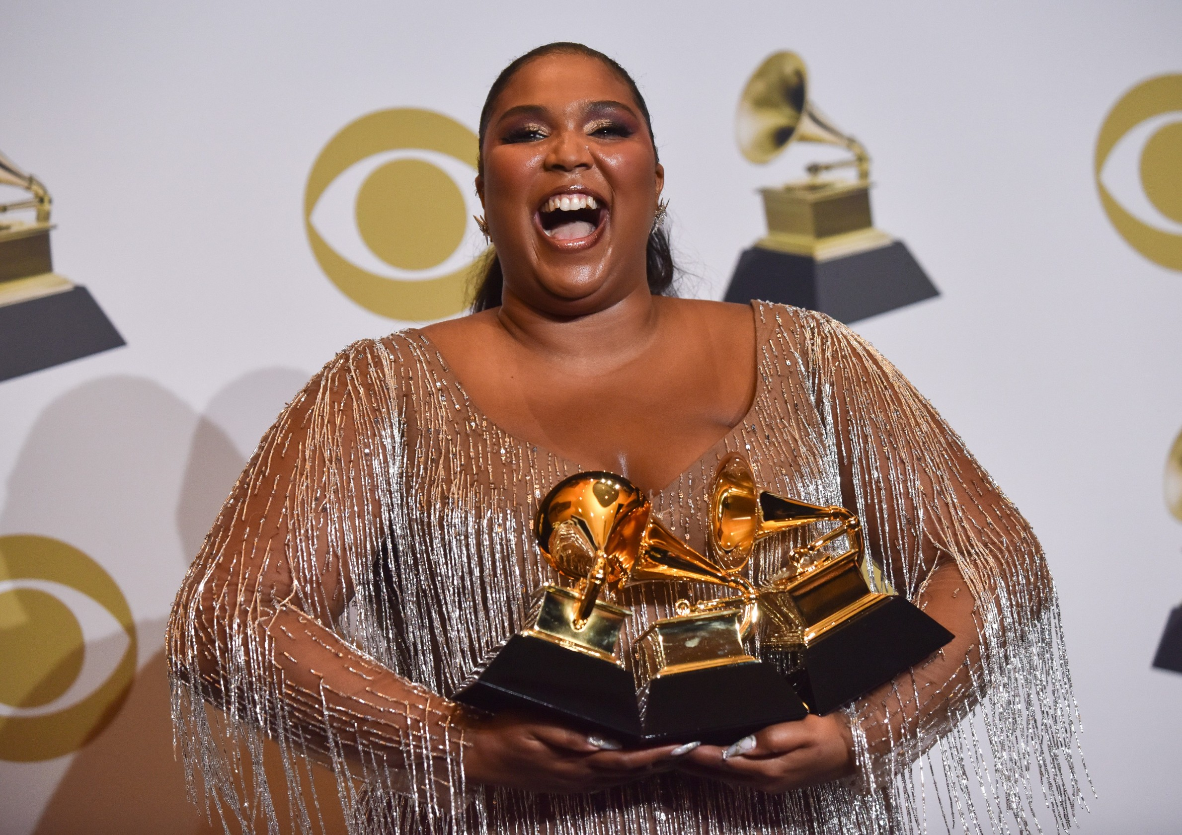 Lizzo appears backstage with her award for Best Traditional R&B Performance for 'Jerome' and Best Urban Contemporary Album award for 'Cuz I Love You (Deluxe),' during the 62nd annual Grammy Awards held at Staples Center in Los Angeles on Sunday, January 26, 2020 .  Photo by /UPI, Image: 494979045, License: Rights-managed, Restrictions: , Model Release: no, Credit line: CHRISTINE CHEW / UPI / Profimedia