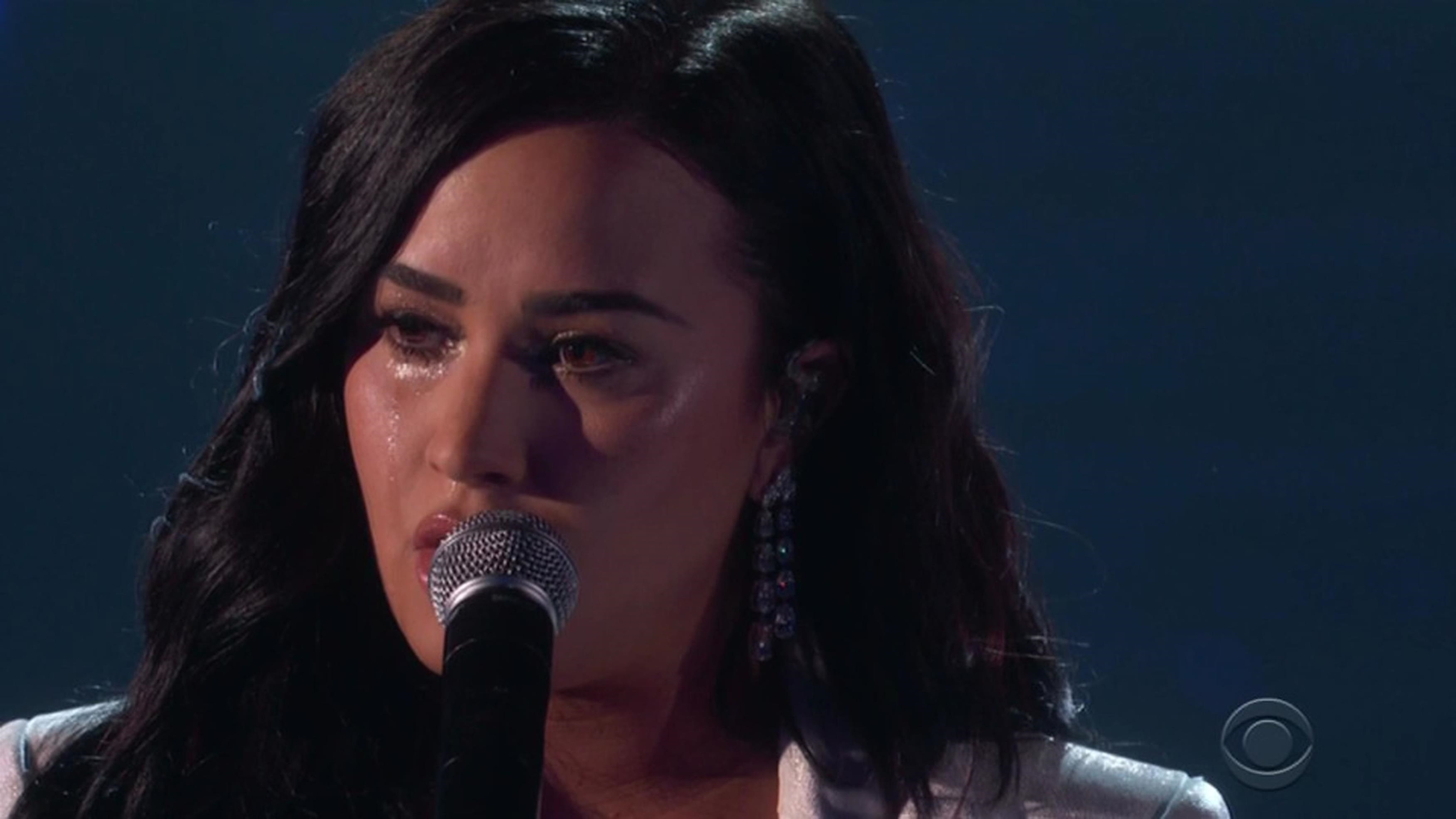 """Los Angeles, CA  - Demi Lovato gives a premiere performance of Anyone at the Grammys - and is so emotional she stops and restarts the song. Demi Lovato performed live for the first time in nearly two years at the 62nd Grammy Awards on Sunday. She was returning to the stage for the first time since she almost lost her life last year. The singer, 27, debuted her new song Anyone and looked stunning in a white gown. After an introduction by Little Women director Greta Gerwing, Lovato was so overcome with emotion when she began to sing she paused to collect herself before starting the song again. The lyrics touched upon her overdose in July 2018 and how she spent time in rehab and therapy overcoming her addiction. Demi wrote and recorded Anyone just four days before suffering the overdose. The single will reportedly be included on Lovato's upcoming album. After Demi initially appeared overcome with emotion and asked her pianist to restart the song from the beginning, the performance went smoothly and Lovato let loose a series of full-throated, searching hooks. """"Is there anyone?"""" she sang. """"I need someone."""" Before taking the stage at the Los Angeles Staples Centre, Lovato discussed her new track in an interview with Apple Music's Beats 1 this week. """"I wish I could go back in time and help that version of myself,"""" Lovato told Zane Lowe. """"I listen back to these lyrics and I hear it as a cry for help."""" Mentioning her hospital stay, she remembered thinking: """"If I ever come back, I want to sing this song.""""  *BACKGRID DOES NOT CLAIM ANY COPYRIGHT OR LICENSE IN THE ATTACHED MATERIAL. ANY DOWNLOADING FEES CHARGED BY BACKGRID ARE FOR BACKGRID'S SERVICES ONLY, AND DO NOT, NOR ARE THEY INTENDED TO, CONVEY TO THE USER ANY COPYRIGHT OR LICENSE IN THE MATERIAL. BY PUBLISHING THIS MATERIAL , THE USER EXPRESSLY AGREES TO INDEMNIFY AND TO HOLD BACKGRID HARMLESS FROM ANY CLAIMS, DEMANDS, OR CAUSES OF ACTION ARISING OUT OF OR CONNECTED IN ANY WAY WITH USER'S PUBLICATION OF THE MATERIAL*  BA"""