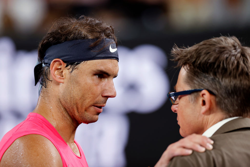 MELBOURNE, AUSTRALIA - JANUARY 29: Rafael Nadal of Spain talks to an official during his Men's Singles Quarterfinal match against Dominic Thiem of Austria on day ten of the 2020 Australian Open at Melbourne Park on January 29, 2020 in Melbourne, Australia. (Photo by Darrian Traynor/Getty Images)