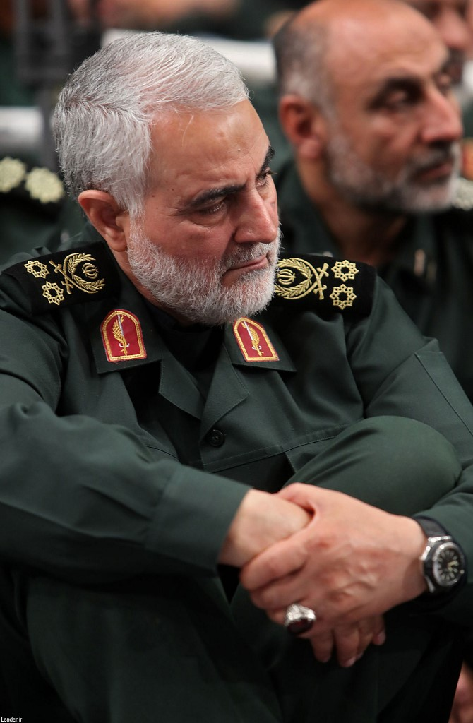 A handout picture provided by the office of Iran's Supreme Leader Ayatollah Ali Khamenei on October 2, 2019 shows Qasem Soleimani (L), Iran's Islamic Revolutionary Guard Corps (IRGC) Major General and commander of the Quds Force, attending a speech given by the Supreme Leader during a meeting in Tehran. (Photo by - / KHAMENEI.IR / AFP) / === RESTRICTED TO EDITORIAL USE - MANDATORY CREDIT