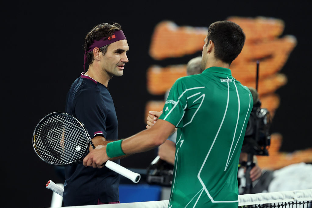 MELBOURNE, AUSTRALIA - JANUARY 30: Novak Djokovic of Serbia shakes hands with Roger Federer of Switzerland after their Men's Singles Semifinal match on day eleven of the 2020 Australian Open at Melbourne Park on January 30, 2020 in Melbourne, Australia. (Photo by Clive Brunskill/Getty Images)