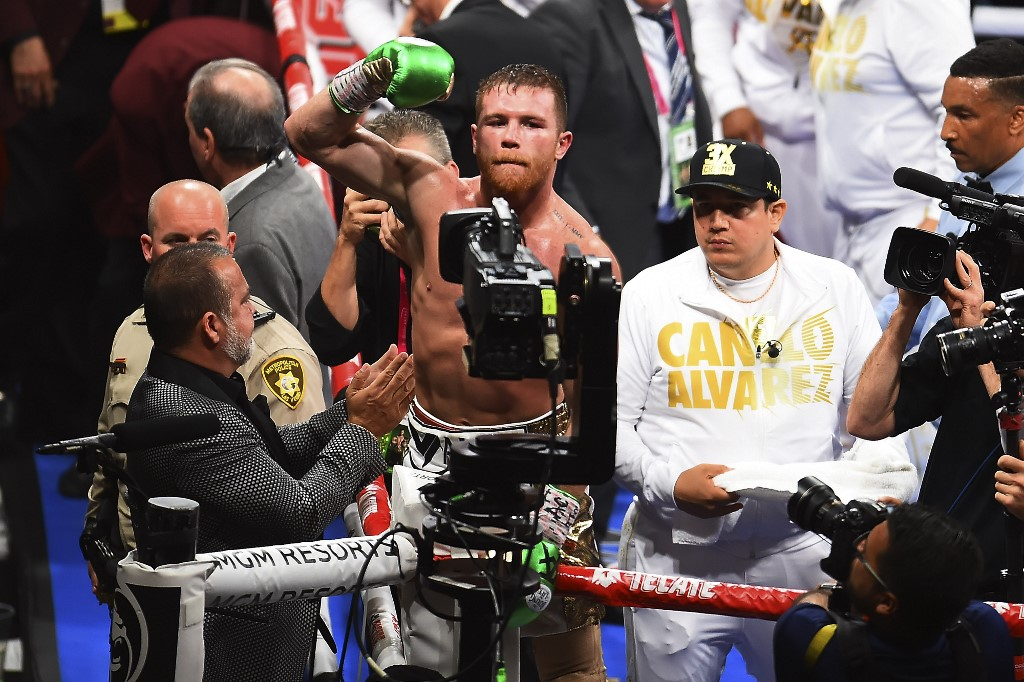 (L-R) Saúl -CANELO- ÁLVAREZ (MEX) vs Daniel JACOBS (USA) during the box fight - WBC - WBA - IBF - RING MIDDLEWEIGHT TITLES, 12 ROUNS, at the T-MOBILE Arena, Las Vegas, Nevada, United States, on May 4, 2019  <br><br>  (I-D), Saúl -CANELO- ÁLVAREZ (MEX) vs Daniel JACOBS (USA) durante la pelea de Box - WBC - WBA - IBF - RING MIDDLEWEIGHT TITLES, 12 ROUNS, en el T-MOBILE Arena, Las Vegas, Nevada, Estados Unidos, el 04 de Mayo de 2019.