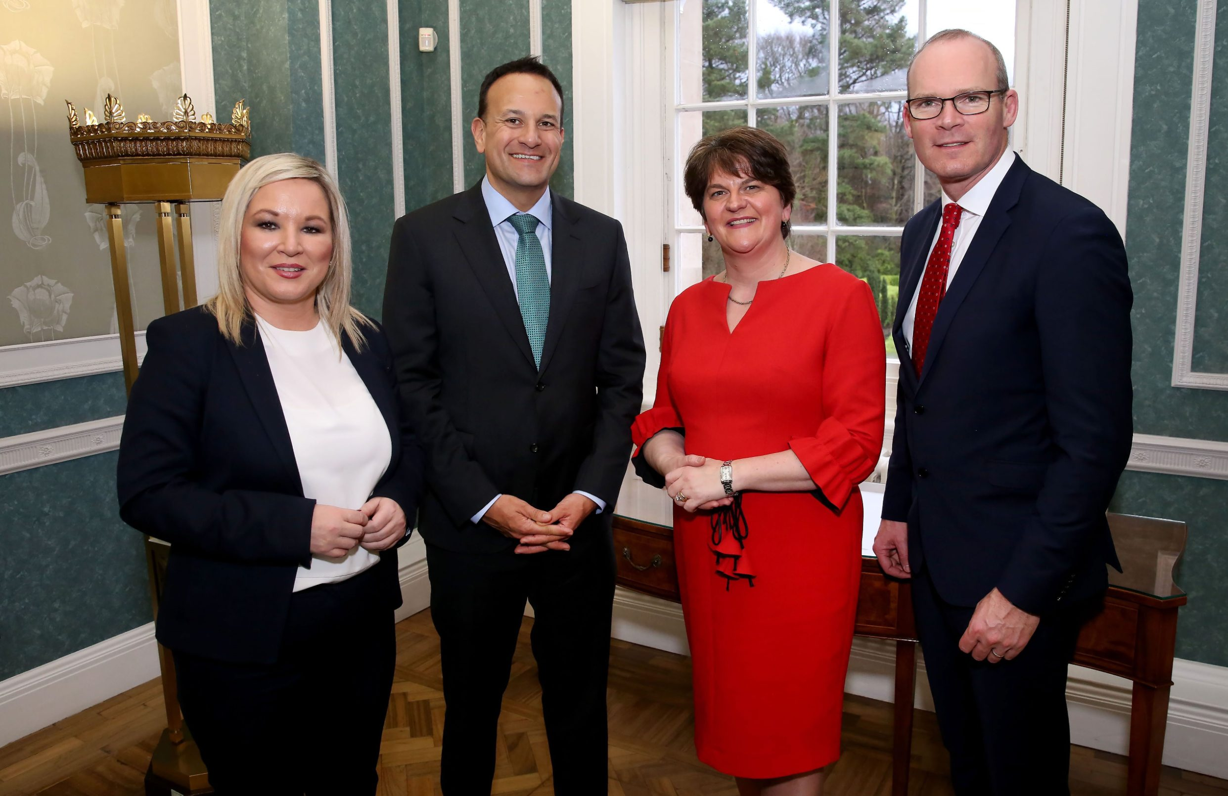 (L-R) Northern Ireland's Deputy First Minister Michelle O'Neill, Ireland's Prime Minister Leo Varadkar, Northern Ireland's First Minister Arlene Foster and Ireland's Foreign Minister Simon Coveney pose for a photograph at the Parliament Buildings, the seat of the of the Northern Ireland Assembly, on the Stormont Estate in Belfast on January 13, 2020. - British Prime Minister Boris Johnson promised a