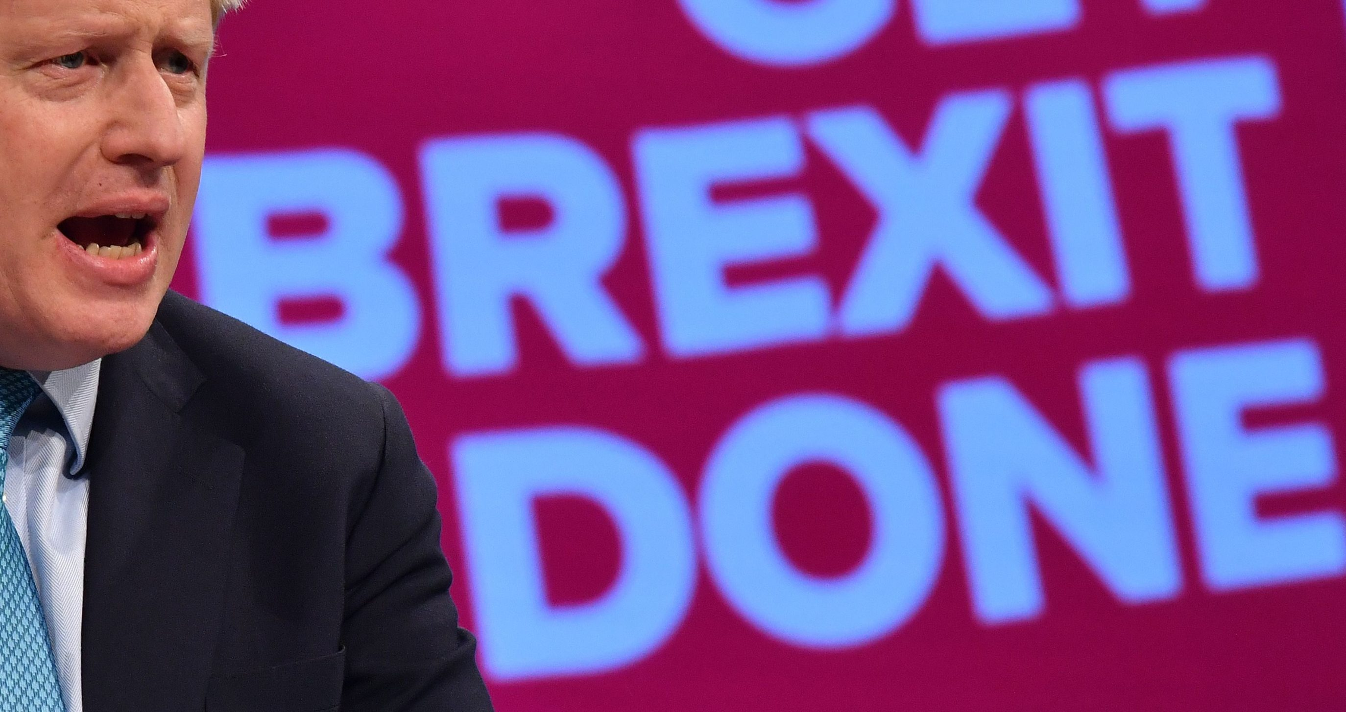 (FILES) In this file photo taken on October 02, 2019 Britain's Prime Minister Boris Johnson delivers his keynote speech to delegates on the final day of the annual Conservative Party conference at the Manchester Central convention complex, in Manchester, north-west England. - Britain is set to leave the European Union at 2300 GMT on January 31, 2020, 43 months after Britons voted in the June 2016 referendum to leave the EU, ending more than four decades of economic, political and legal integration with its closest neighbours. (Photo by Ben STANSALL / AFP)