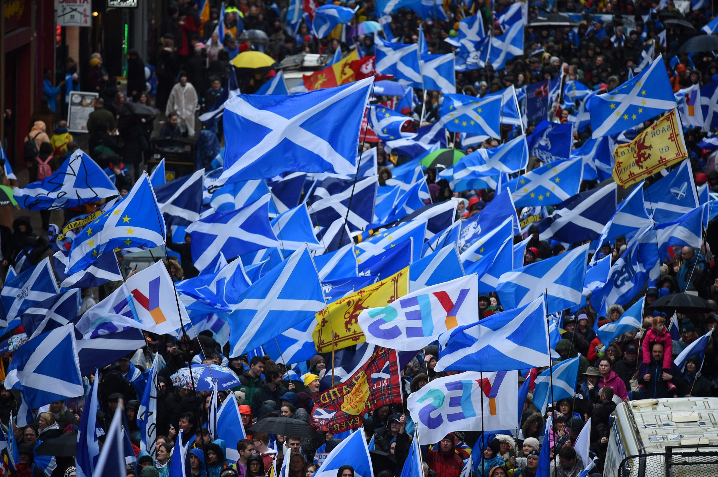 (FILES) In this file photo taken on January 11, 2020 Protesters with Scottish Saltire flags attend a march organised by the grassroots organistaion All Under One Banner calling for Scottish independence in Glasgow. - Britain's January 31, 2020 departure from the European Union has revived the debate for an independent Scotland, which was thought to have been settled in a landmark referendum nearly six years ago. Scots voted by a majority of 55 percent to remain part of the United Kingdom in 2014, effectively taking the issue off the table in what was described as a