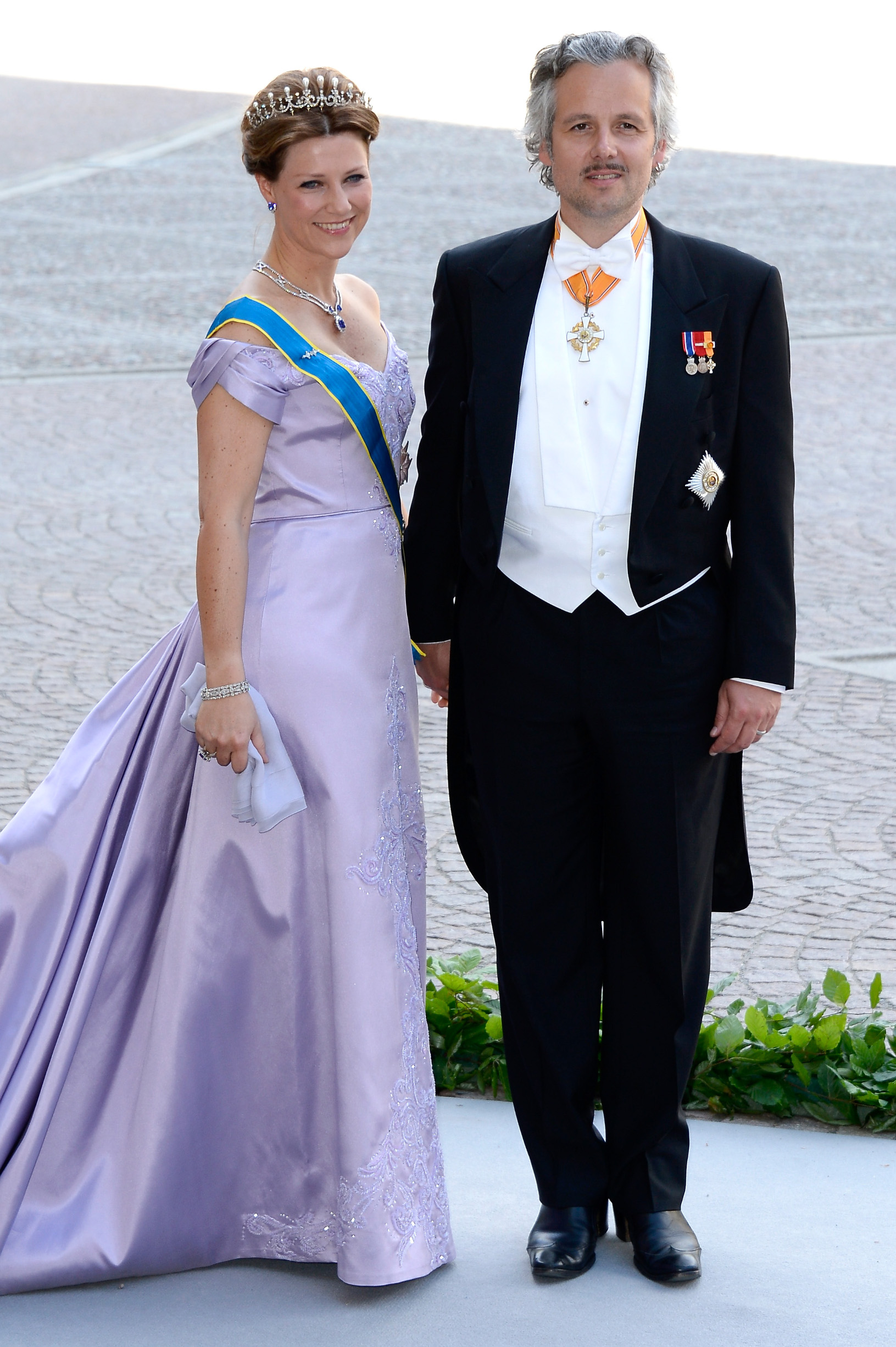 STOCKHOLM, SWEDEN - JUNE 08:  Princess Martha Louise of Norway and Ari Mikael Behn attend the wedding of Princess Madeleine of Sweden and Christopher O'Neill hosted by King Carl Gustaf XIV and Queen Silvia at The Royal Palace on June 8, 2013 in Stockholm, Sweden.  (Photo by Pascal Le Segretain/Getty Images)