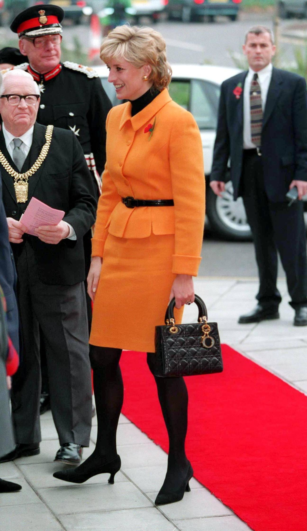 PRINCESS DIANA IN LIVERPOOL, BRITAIN - 1995  PRINCESS DIANA  ARRIVING TO OPEN THE LIVERPOOL WOMENS HOSPITAL PRINCESS DIANA IN LIVERPOOL, BRITAIN - 1995  BRITISH ORANGE SUIT, Image: 221342063, License: Rights-managed, Restrictions: , Model Release: no, Credit line: Tim Rooke / Shutterstock Editorial / Profimedia