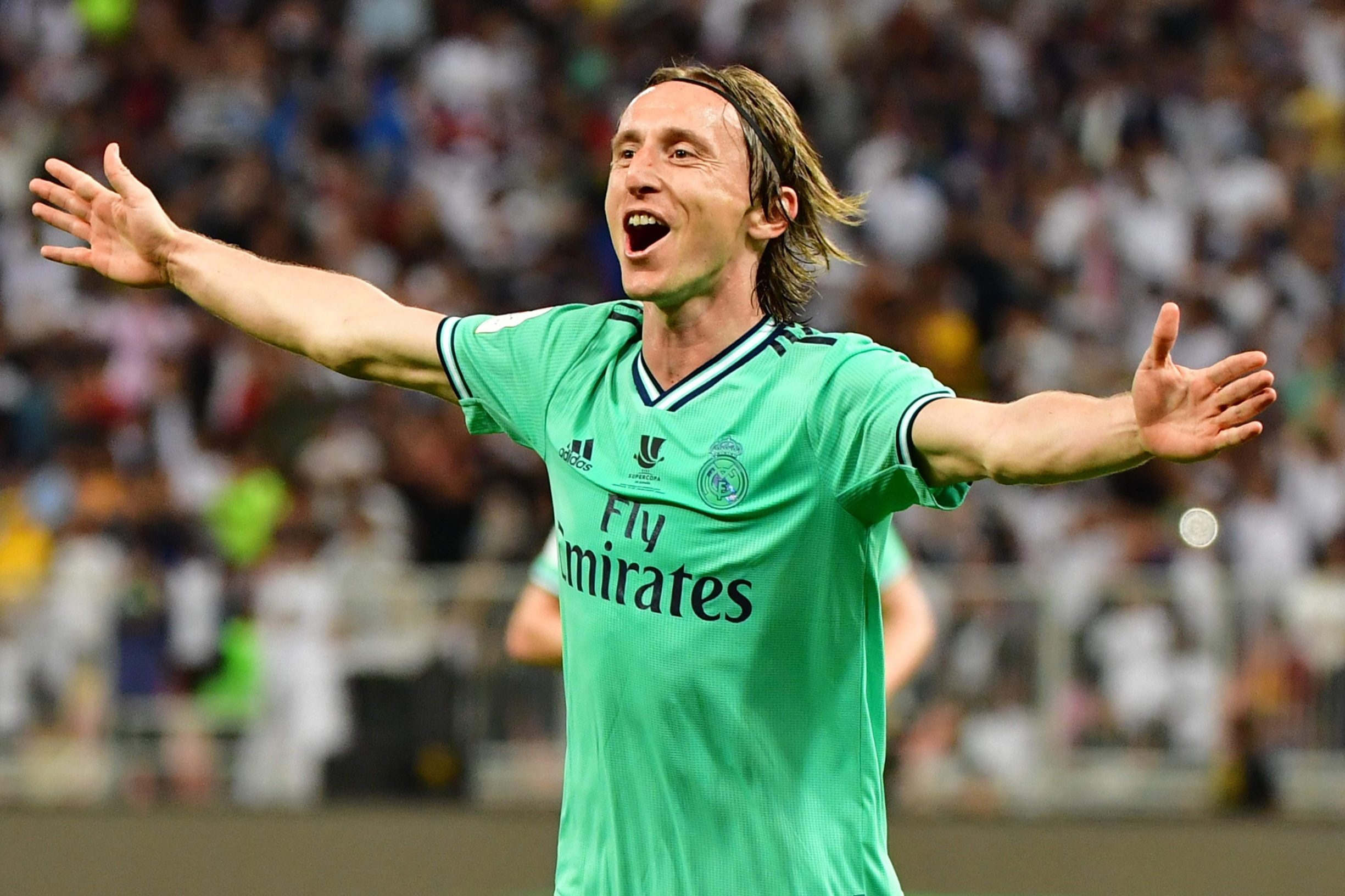 Real Madrid's Croatian midfielder Luka Modric celebrates his goal during the Spanish Super Cup semi final between Valencia and Real Madrid on January 8, 2020, at the King Abdullah Sport City in the Saudi Arabian port city of Jeddah. (Photo by GIUSEPPE CACACE / AFP)