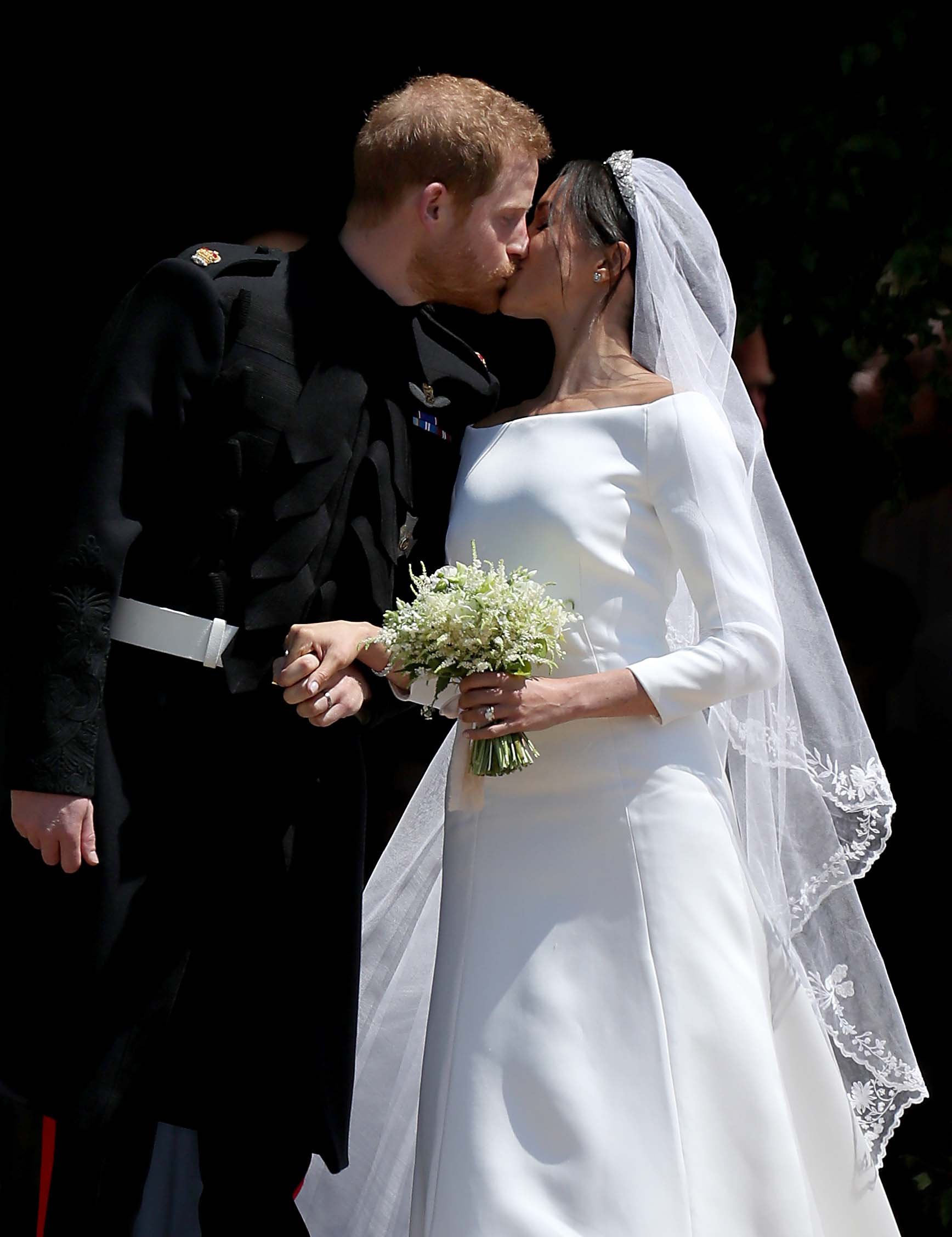 WINDSOR, UNITED KINGDOM - MAY 19:  Prince Harry, Duke of Sussex and The Duchess of Sussex share a kiss after their wedding at St George's Chapel at Windsor Castle on May 19, 2018 in Windsor, England. (Photo by Jane Barlow - WPA Pool/Getty Images)