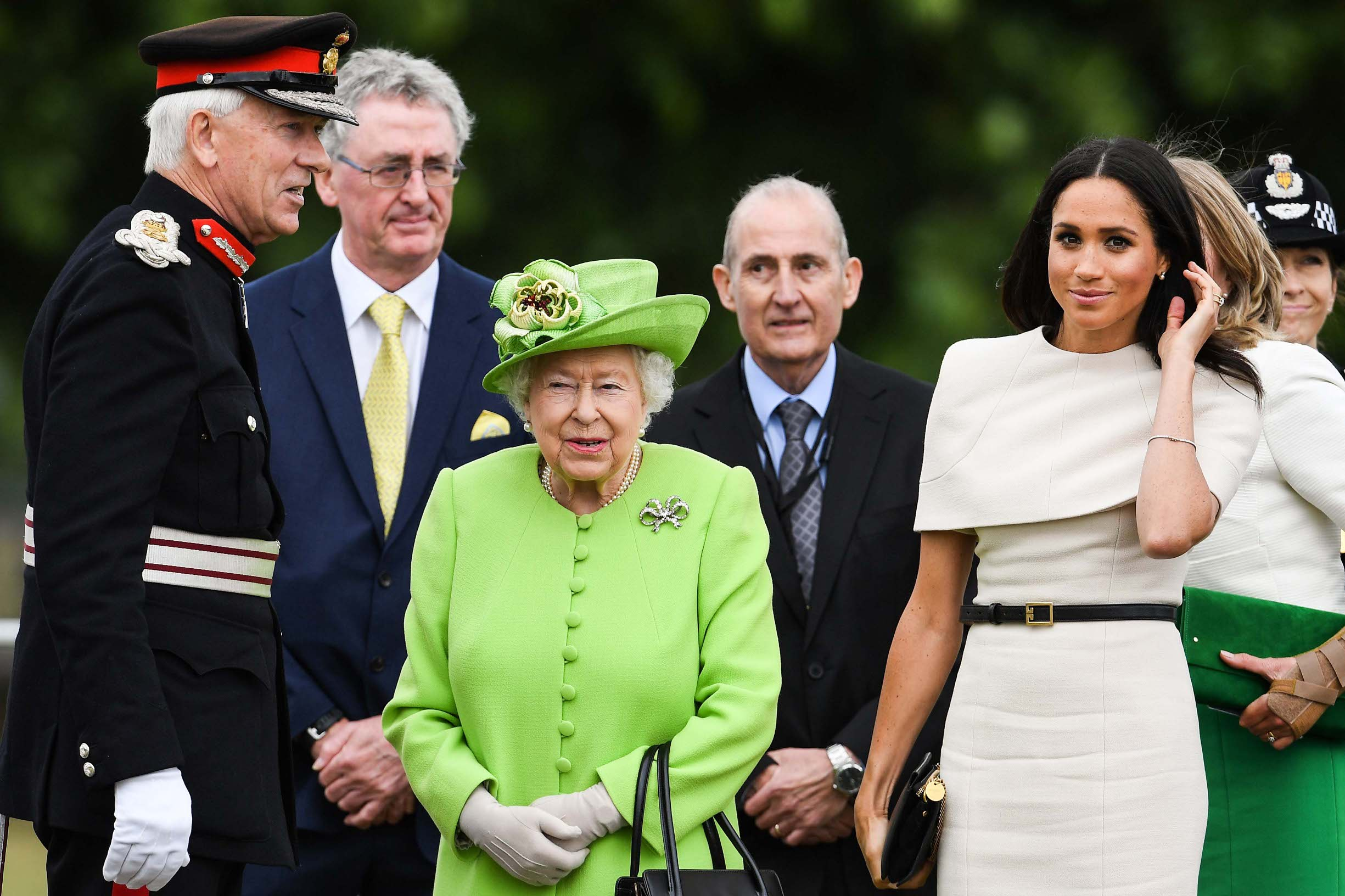 CHESTER, ENGLAND - JUNE 14:  Queen Elizabeth II and Meghan, Duchess of Sussex arrive to open the new Mersey Gateway Bridge on June 14, 2018 in the town of Widnes in Halton, Cheshire, England. Meghan Markle married Prince Harry last month to become The Duchess of Sussex and this is her first engagement with the Queen. During the visit the pair will open a road bridge in Widnes and visit The Storyhouse and Town Hall in Chester.  (Photo by Jeff J Mitchell/Getty Images)