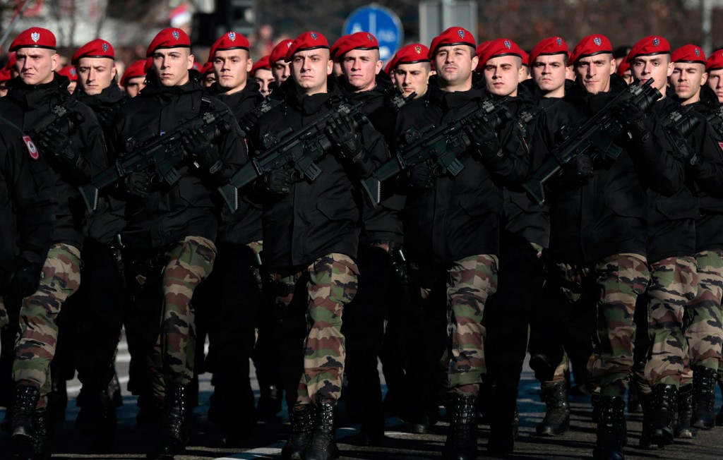Bosnian Serb police officers take part in a parade marking the