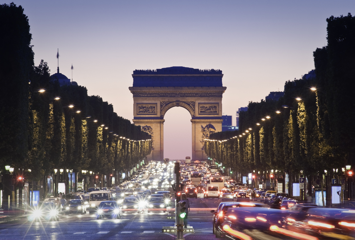 Pretty night time illuminations of the Impressive Arc de Triomphe (1833) along the famous tree lined Avenue des Champs-Elysees in Paris. ProPhoto profile for precise color reproduction.