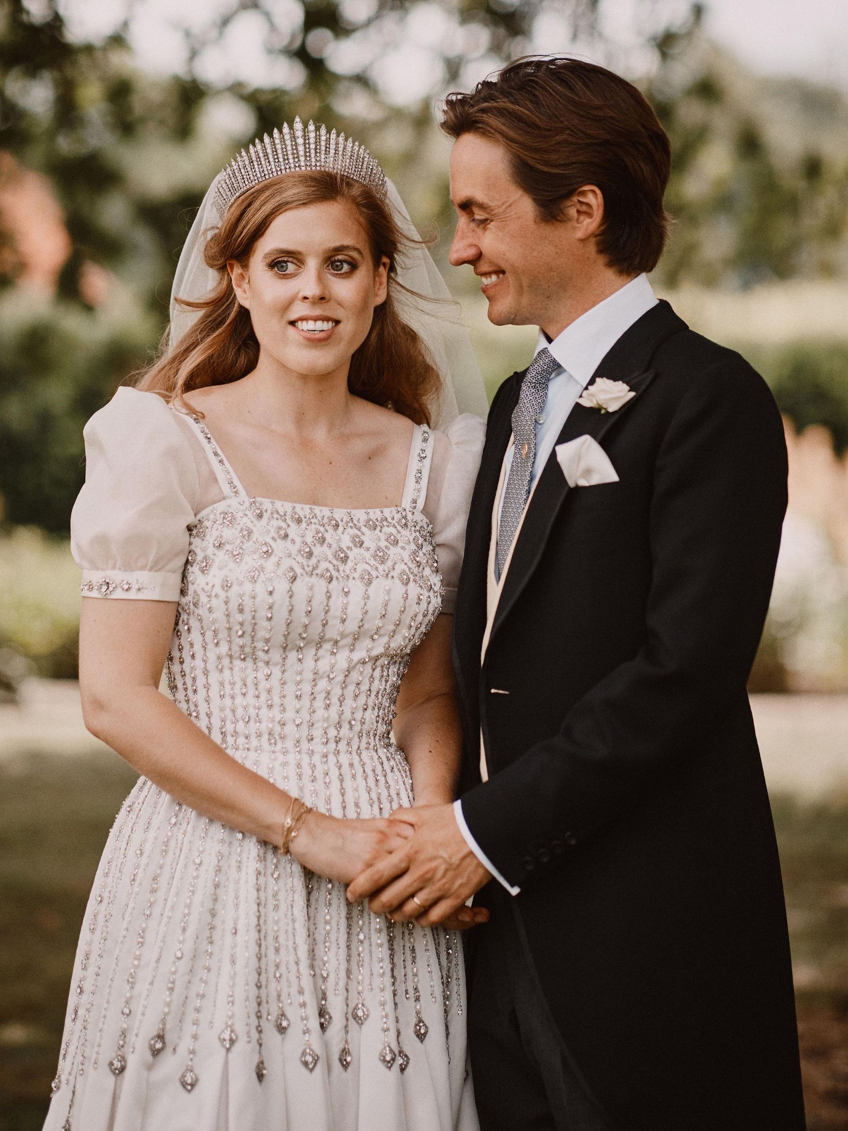 Official wedding photograph of Princess Beatrice and Edoardo Mapelli Mozzi after their wedding at The Royal Chapel of All Saints at Royal Lodge, Windsor, Berkshire, UK, on the 17th July 2020.  Picture by Benjamin Wheeler/WPA-Pool  NEWS EDITORIAL USE ONLY. NO COMMERCIAL USE. NO MERCHANDISING, ADVERTISING, SOUVENIRS, MEMORABILIA or COLOURABLY SIMILAR. NOT FOR USE AFTER 18th January 2021  WITHOUT PRIOR PERMISSION FROM BUCKINGHAM PALACE. NO CROPPING.   The photograph must not be digitally enhanced, manipulated or modified in any manner or form and must include all of the individuals in the photograph when published. //GEORGEROGERS_WED2292/2007191755/Credit:GEORGE ROGERS-POOL/SIPA/2007191755,Image: 544928621, License: Rights-managed, Restrictions: , Model Release: no, Credit line: GEORGE ROGERS-POOL / Sipa Press / Profimedia