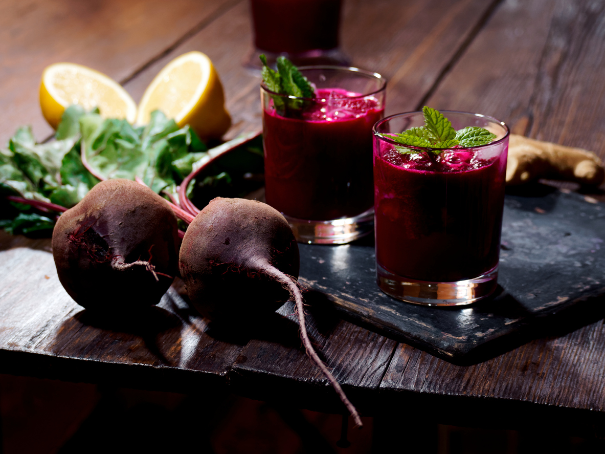 Serving beet smoothie with ginger and lemon