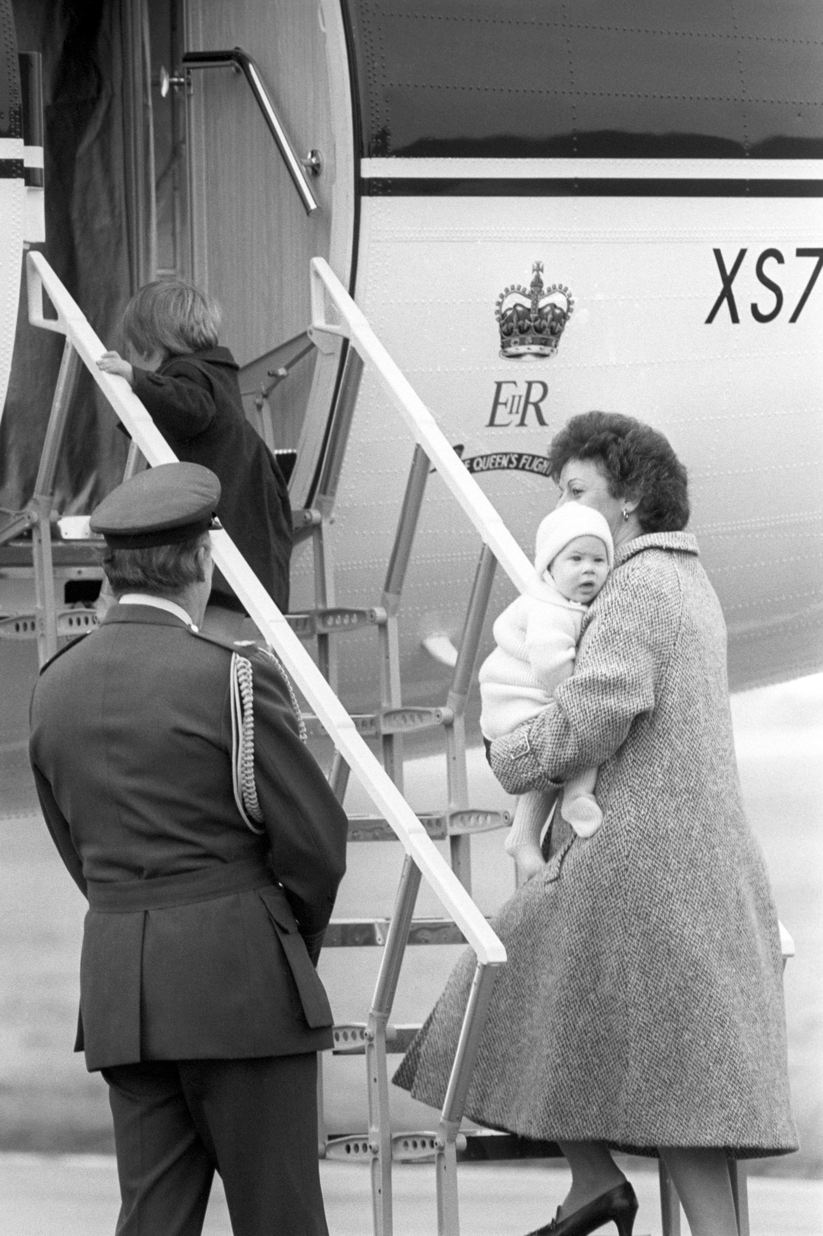 File photo dated 25/03/85 of Prince William, who will be three in June, walks aboard the aircraft while his six-month-old brother Prince Harry is carried aboard by nanny Barbara Barnes at Dyce Airport in Aberdeen. The children were flying back to London with their mother the Princess of Wales in an aircraft of the Queen's Flight. The Duke of Sussex was a cuddly child who was fearless and mischievous even at a young age.,Image: 416971120, License: Rights-managed, Restrictions: FILE PHOTO, Model Release: no, Credit line: PA / PA Images / Profimedia
