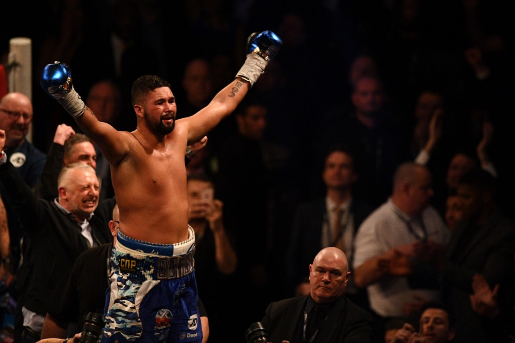 British boxer Tony Bellew celebrates after defeating British compatriot David Haye in their heavyweight boxing match at the O2 Arena in London on March 4, 2017. (Photo by Justin TALLIS / AFP)