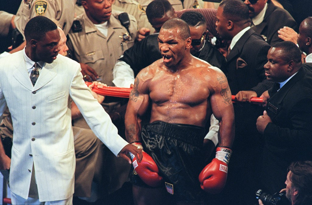 Mike Tyson reacts after being disqualified at the end of the third round of his fight with WBA heavyweight champion Evander Holyfield in the MGM Grand Garden Arena 28 June 1997. Holyfield won by disqualification after being bitten by Tyson.  AFP PHOTO/JOHN GURZINSKY (Photo by JOHN GURZINSKI / AFP)