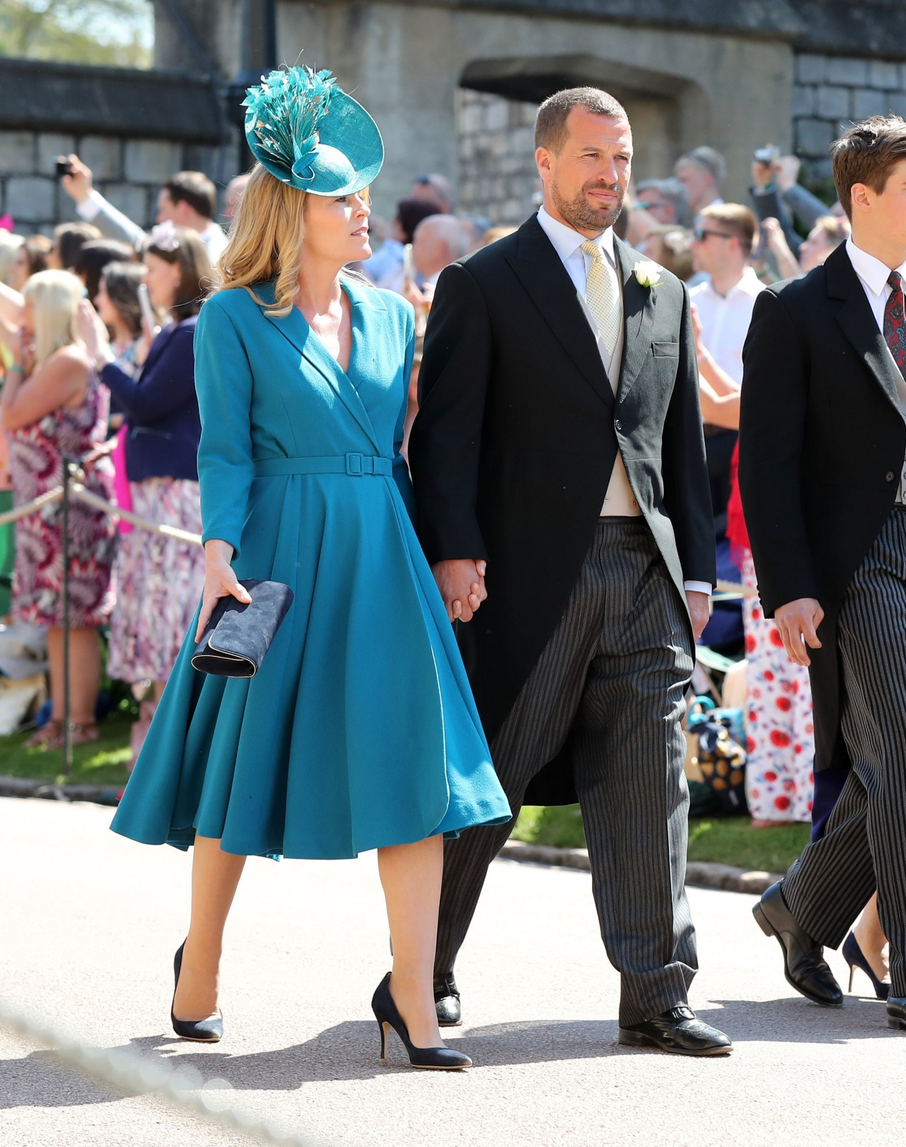 WINDSOR, UNITED KINGDOM - MAY 19:  Peter Phillips and wife Autumn Phillips arrive at St George's Chapel at Windsor Castle before the wedding of Prince Harry to Meghan Markle on May 19, 2018 in Windsor, England. (Photo by Gareth Fuller - WPA Pool/Getty Images)