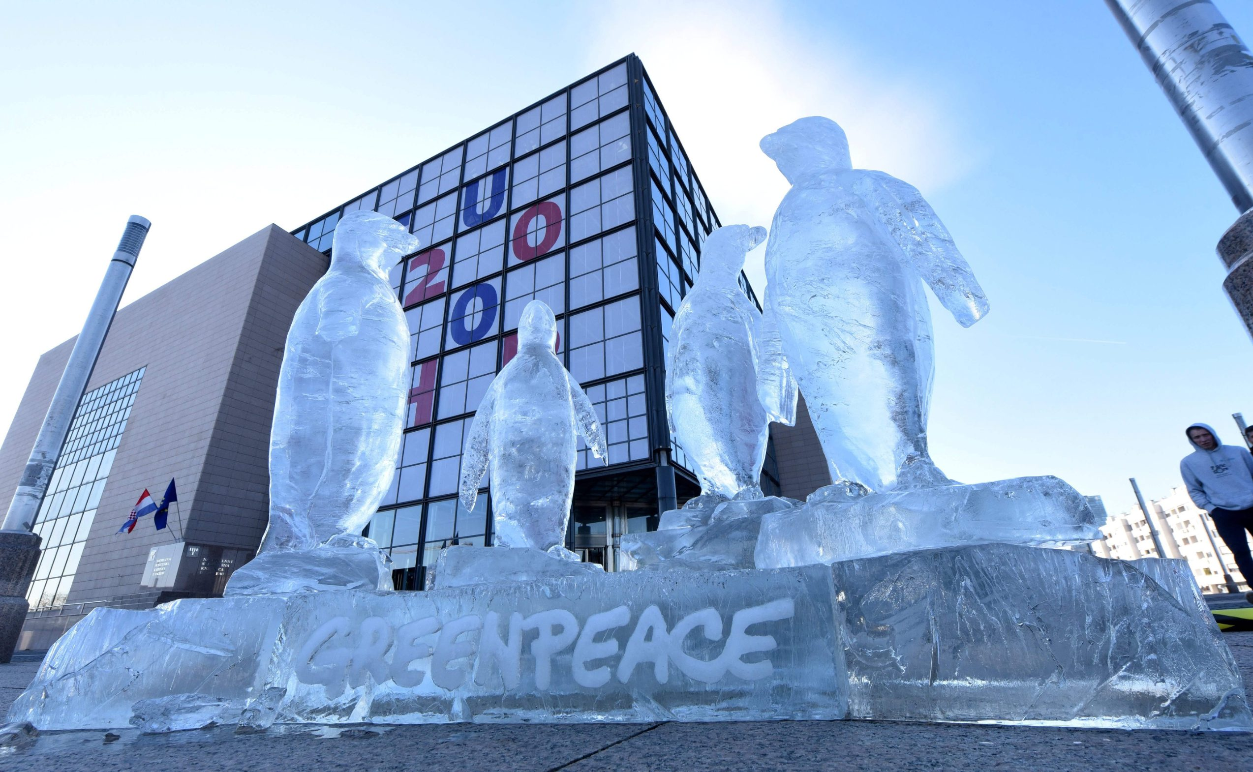 An ice sculpture depicting penguins has  been installed by Greepeance activists outside the national and university library, the seat of Croatia's EU rotating presidency, as part of an international campaign to protect oceans, in Zagreb, on February 7, 2020. (Photo by Denis LOVROVIC / AFP)