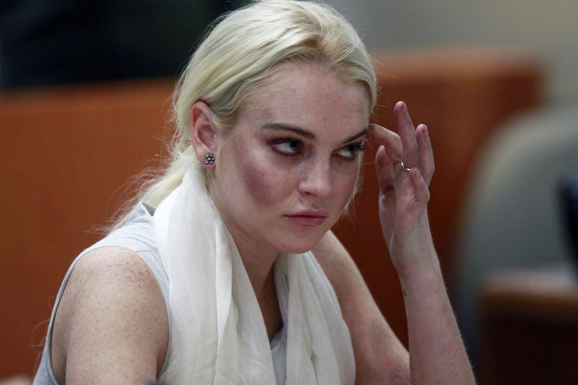 Actress Lindsay Lohan listens as a judge revokes her probation for failing to appear at a series of community service appointments at the Los Angeles Superior Court Airport Branch Courthouse during a progress report hearing in Los Angeles on October 19, 2011., Image: 105054848, License: Rights-managed, Restrictions: , Model Release: no, Credit line: MARK BOSTER / UPI / Profimedia