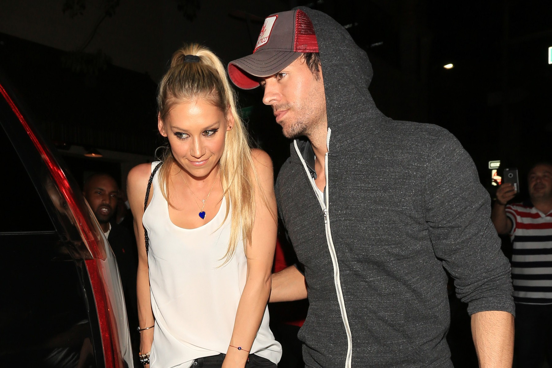 Beverly Hills, CA - Singer, Enrique Iglesias and Anna Kournikova are spotted leaving The Palm after a romantic date night. The pair are greeted by the chaos of fans and cameras hoping to get a glimpse of the couple. Iglesias is kind enough to sign autographs before leaving in his ride.       July 1, 2016, Image: 292935585, License: Rights-managed, Restrictions: NO Brazil, Model Release: no, Credit line: - / Backgrid USA / Profimedia