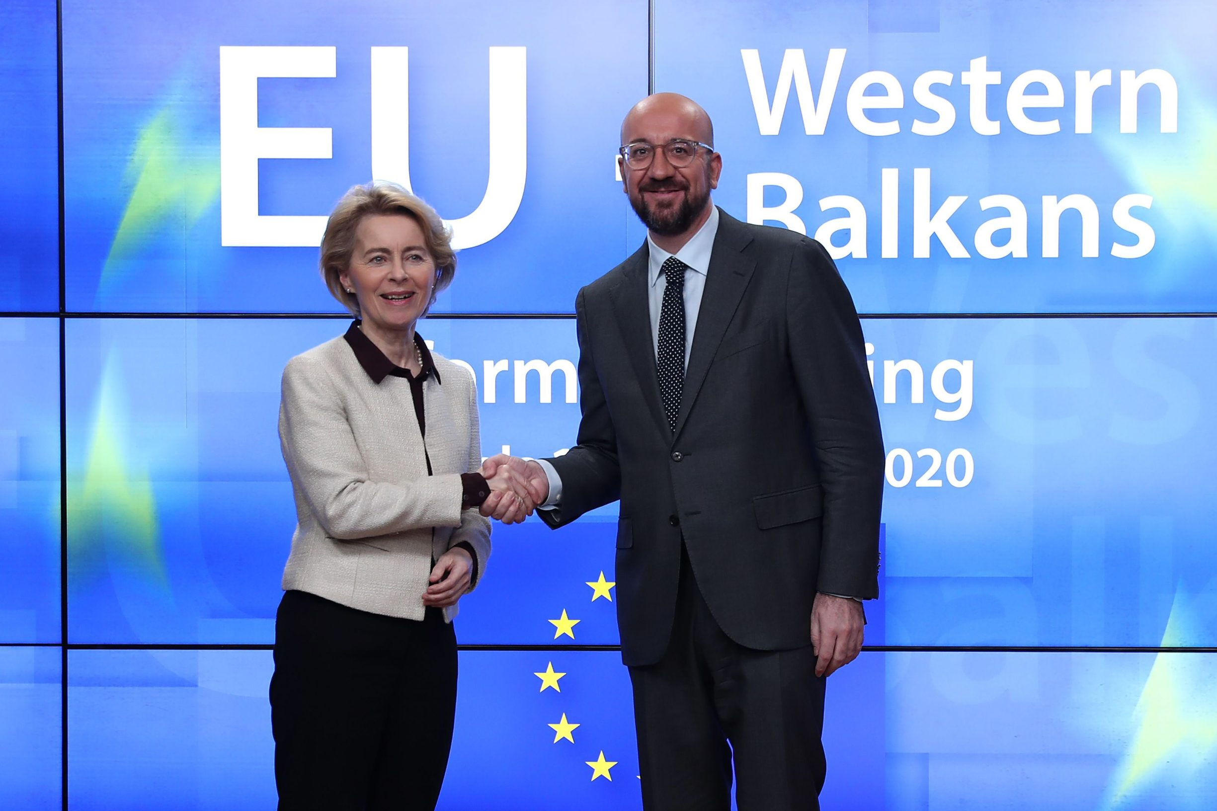 European Commission President Ursula von der Leyen (L) is greeted by European Council President Charles Michel as he arrives for a meeting of the EU-Western Balkans Summit at the EU headquarters in Brussels on February 16, 2020. (Photo by Aris Oikonomou / AFP)