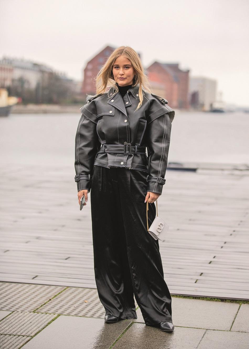 COPENHAGEN, DENMARK - JANUARY 28: Josefine Haaning Jensen seen wearing black leather jacket, wide leg pants, micro bag outside 7 Days on Day 1 during Copenhagen Fashion Week Autumn/Winter 2020 on January 28, 2020 in Copenhagen, Denmark. (Photo by Christian Vierig/Getty Images)