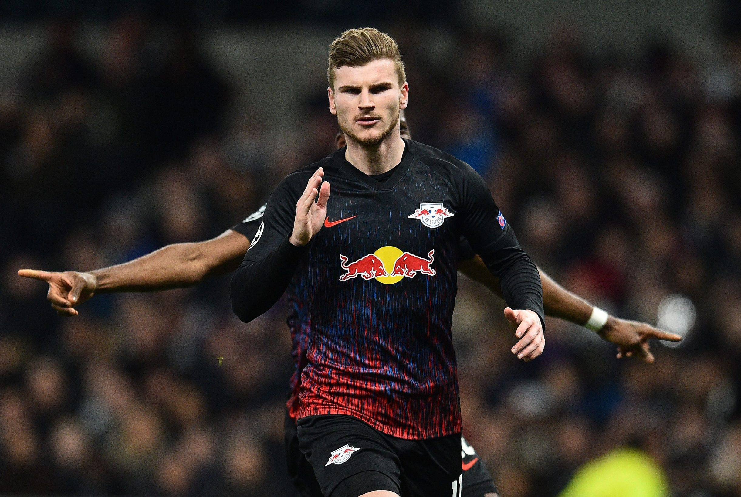 RB Leipzig's German striker Timo Werner celebrates scoring the opening goal from the penalty spot during the UEFA Champions League round of 16 first Leg football match between Tottenham Hotspur and RB Leipzig at the Tottenham Hotspur Stadium in north London, on February 19, 2020. (Photo by Glyn KIRK / IKIMAGES / AFP)