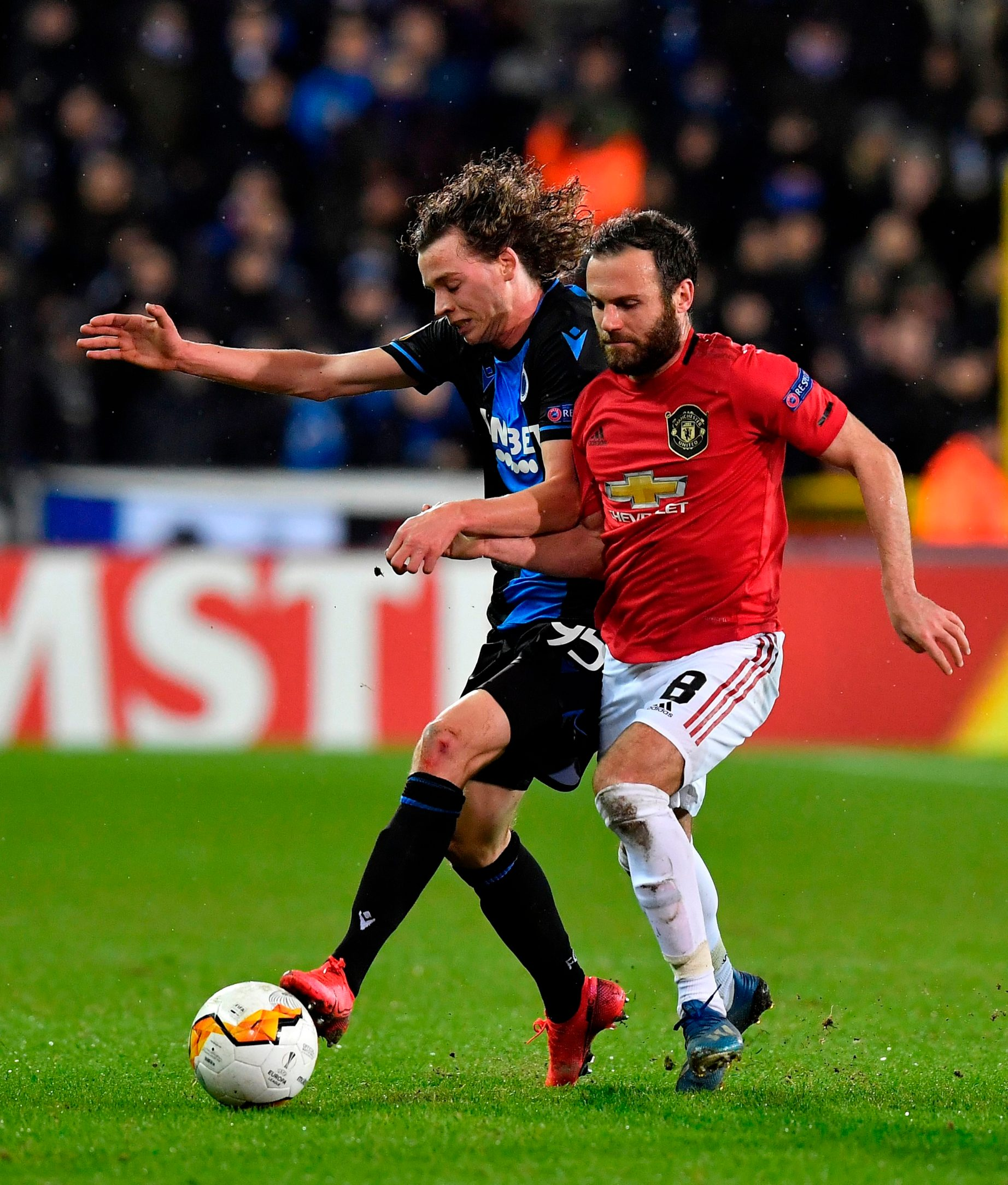 Club Brugge's Belgian forward Maxim De Cuyper (L) fights for the ball with Manchester United' s Spanish midfielder Juan Mata, during the Europa League match between Club Brugge and Manchester United at the Jan Breydel Stadium in Bruges on February 20, 2020. (Photo by JOHN THYS / AFP)