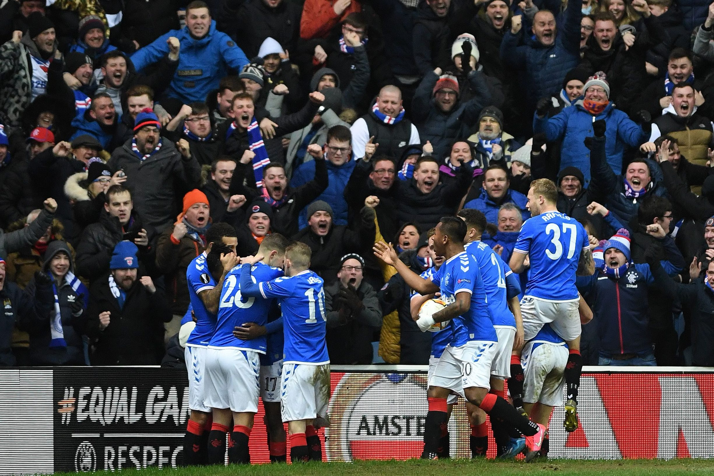 Rangers' English striker Joseph Ayodele-Aribo celebrates scoring his team's second goal during the UEFA Europa League round of 32 first leg football match between Rangers and Sporting Braga at the Ibrox Stadium in Glasgow on February 20, 2020. (Photo by ANDY BUCHANAN / AFP)