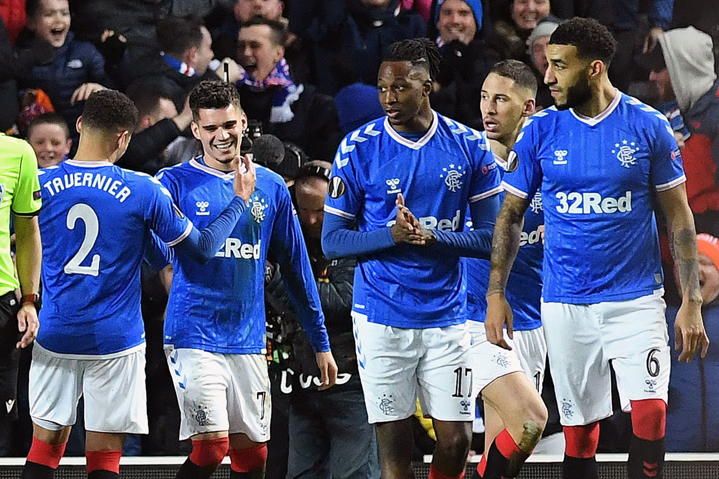 Rangers' Romanian midfielder Ianis Hagi (2L) celebrates scoring his team's third goal during the UEFA Europa League round of 32 first leg football match between Rangers and Sporting Braga at the Ibrox Stadium in Glasgow on February 20, 2020. (Photo by ANDY BUCHANAN / AFP)