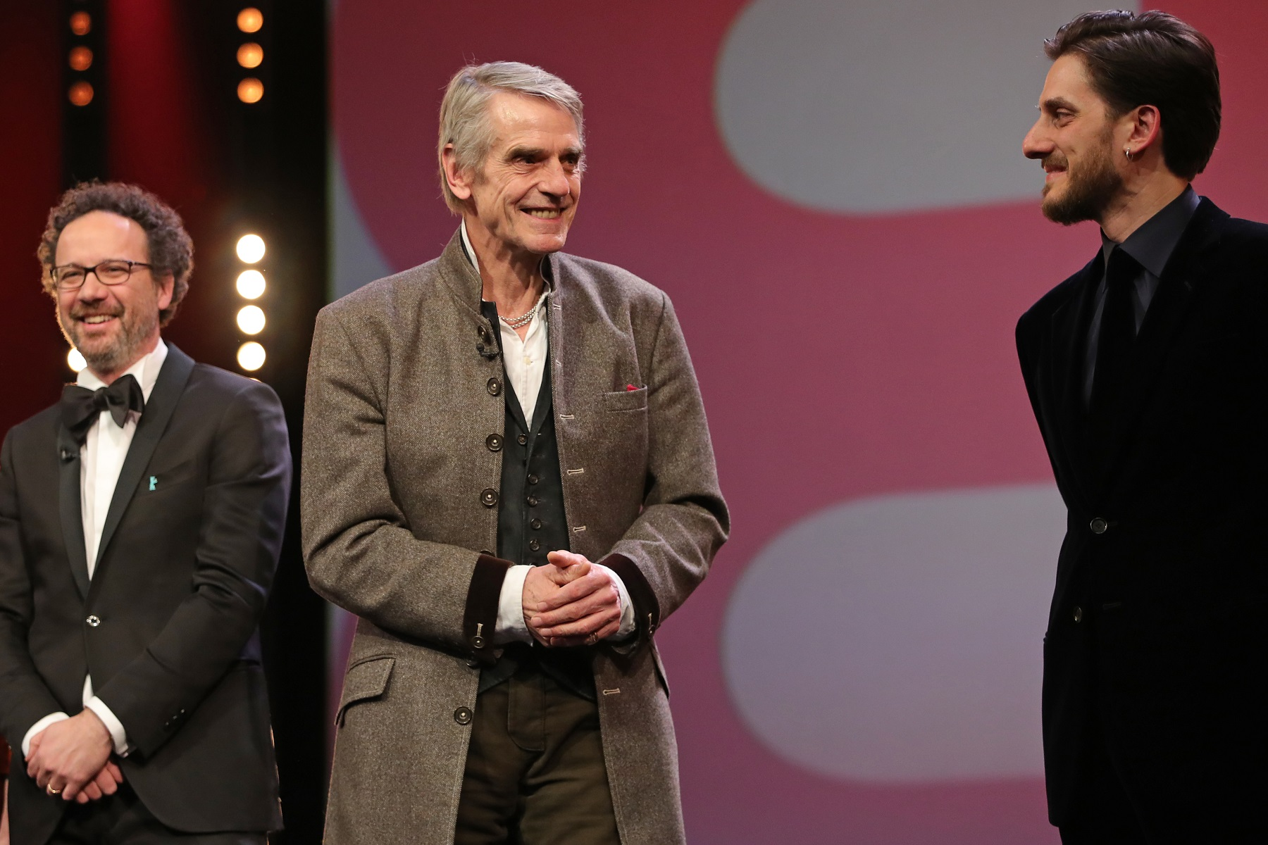 BERLIN, GERMANY - FEBRUARY 20: (L-R) Artistic Director of Berlinale Carlo Chatrian, president of the International Jury Jeremy Irons and jury member Luca Marinelli are seen on stage at the opening ceremony and