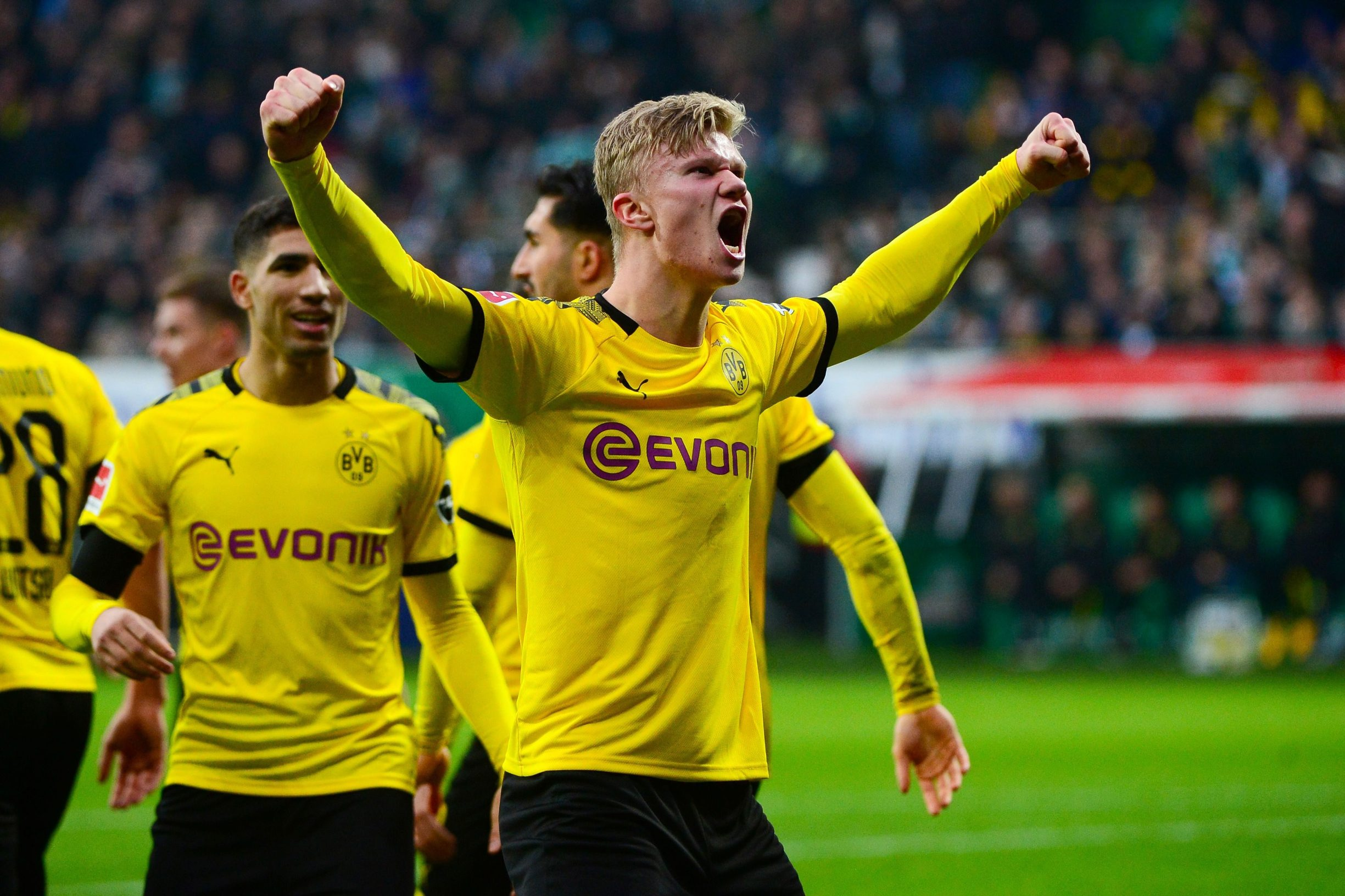 Dortmund's Norwegian forward Erling Braut Haaland celebrates after scoring during the German first division Bundesliga football match Werder Bremen vs BVB Borussia Dortmund, in Bremen, northern Germany on February 22, 2020. (Photo by Patrik Stollarz / AFP) / DFL REGULATIONS PROHIBIT ANY USE OF PHOTOGRAPHS AS IMAGE SEQUENCES AND/OR QUASI-VIDEO