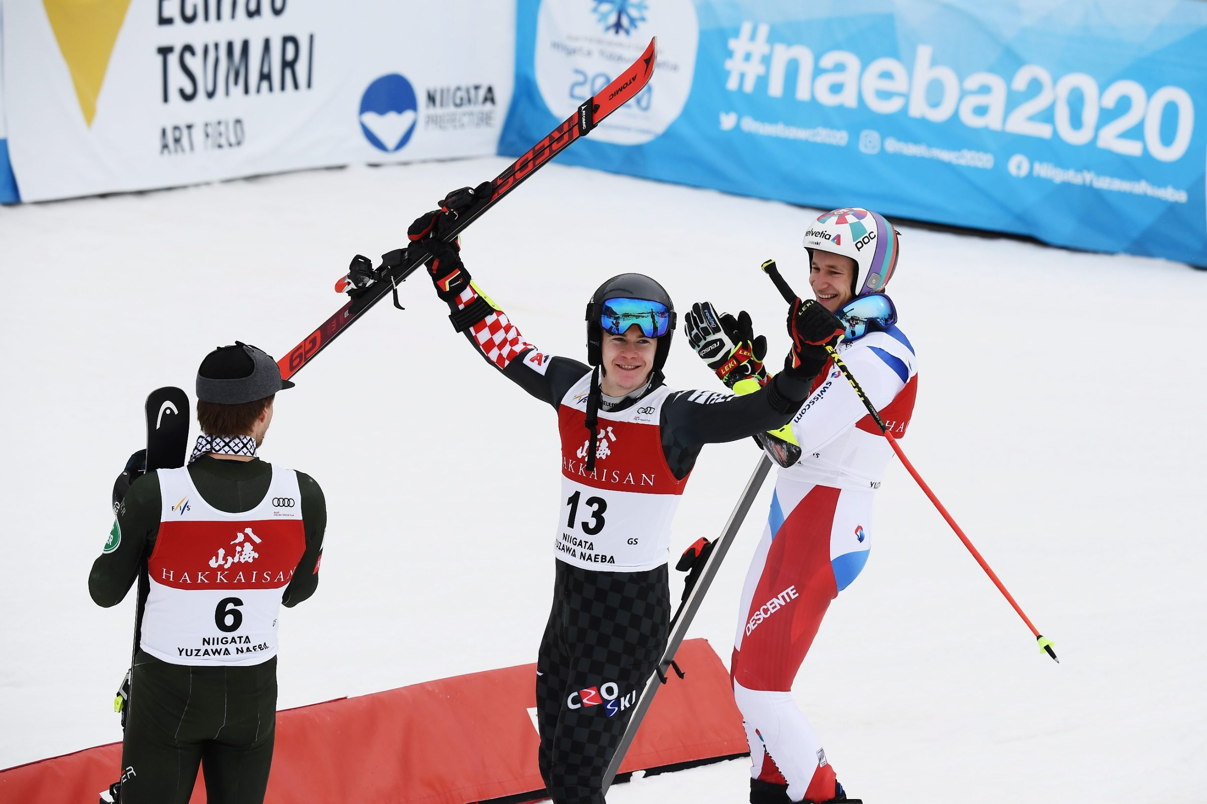 Filip Zubcic of Croatia (C) celebrates the win of the Audi FIS Alpine Ski World Cup Men's Giant Slalom on February 22, 2020 in Yuzawa Naeba, western Japan. (Photo by CHARLY TRIBALLEAU / AFP)