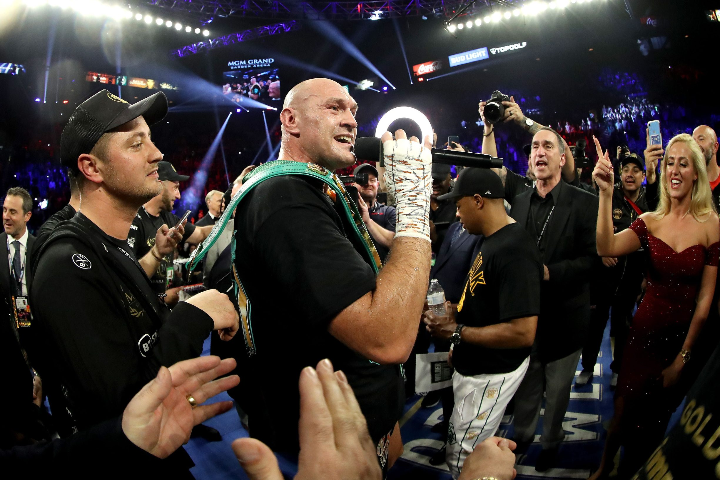 LAS VEGAS, NEVADA - FEBRUARY 22: Tyson Fury sings to his wife Paris Fury and the fans following his win by TKO in the seventh round against Deontay Wilder in the Heavyweight bout for Wilder's WBC and Fury's lineal heavyweight title on February 22, 2020 at MGM Grand Garden Arena in Las Vegas, Nevada.   Al Bello/Getty Images/AFP == FOR NEWSPAPERS, INTERNET, TELCOS & TELEVISION USE ONLY ==