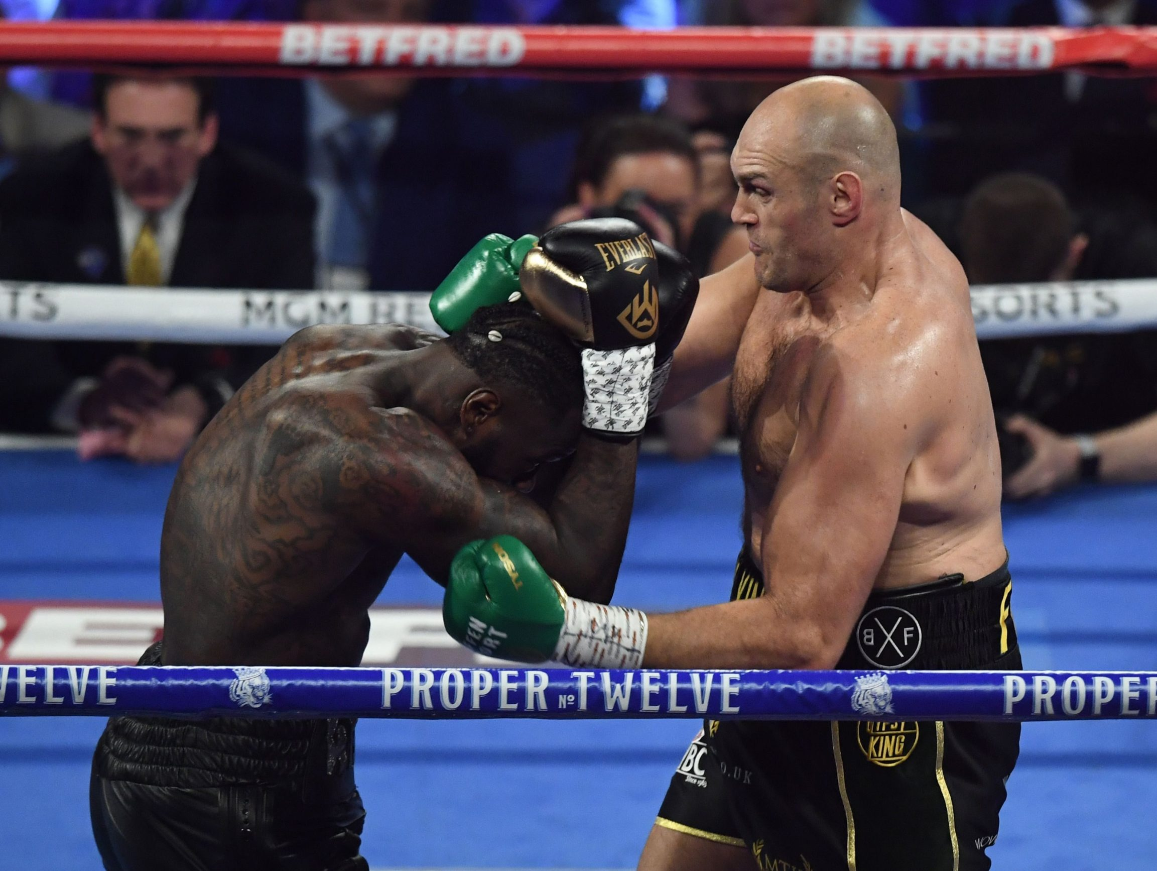 British boxer Tyson Fury (R) lands a punch on US boxer Deontay Wilder during their World Boxing Council (WBC) Heavyweight Championship Title boxing match at the MGM Grand Garden Arena in Las Vegas on February 22, 2020. (Photo by Mark RALSTON / AFP)