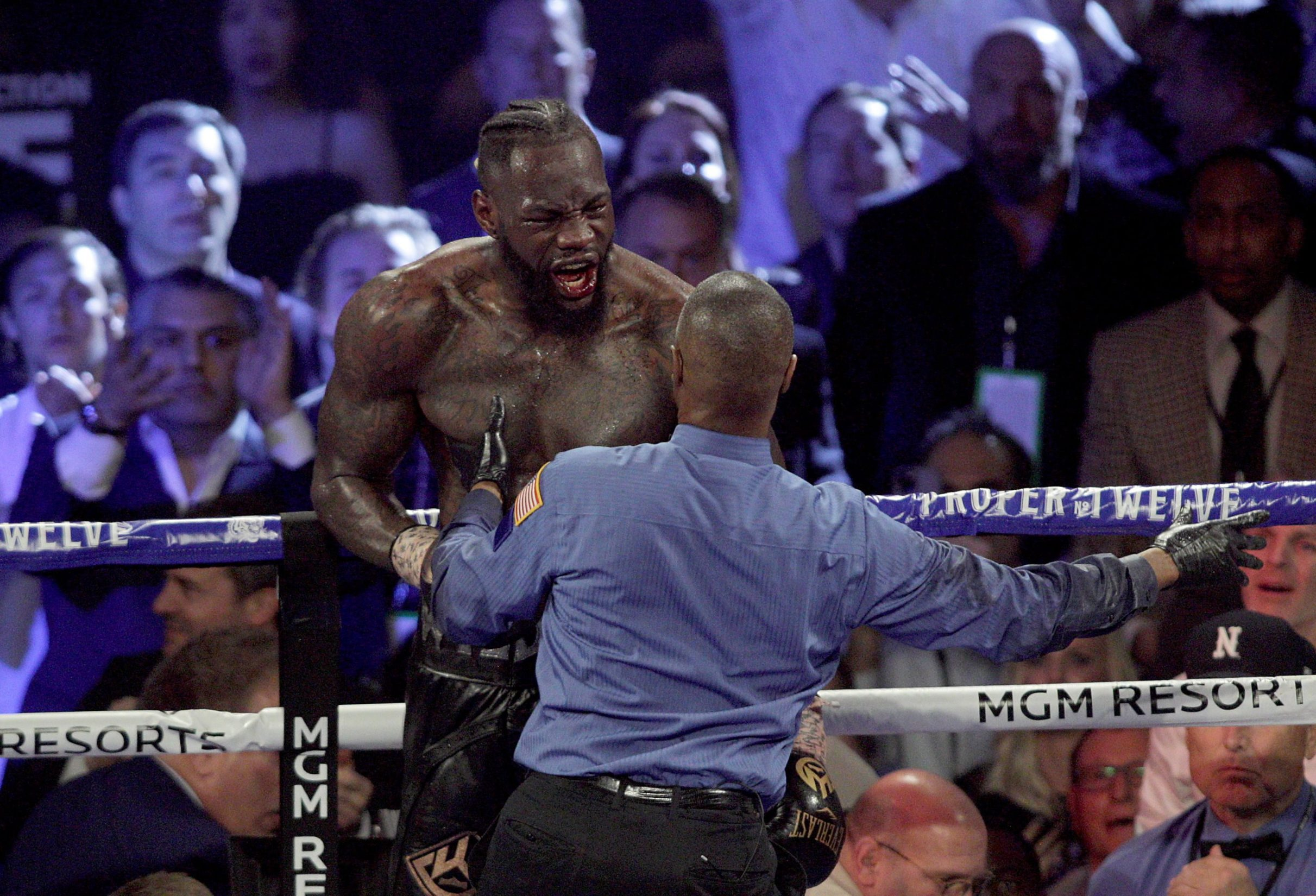 US boxer Deontay Wilder reacts during his World Boxing Council (WBC) Heavyweight Championship Title boxing match against British boxer Tyson Fury at the MGM Grand Garden Arena in Las Vegas on February 22, 2020. (Photo by John Gurzinski / AFP)