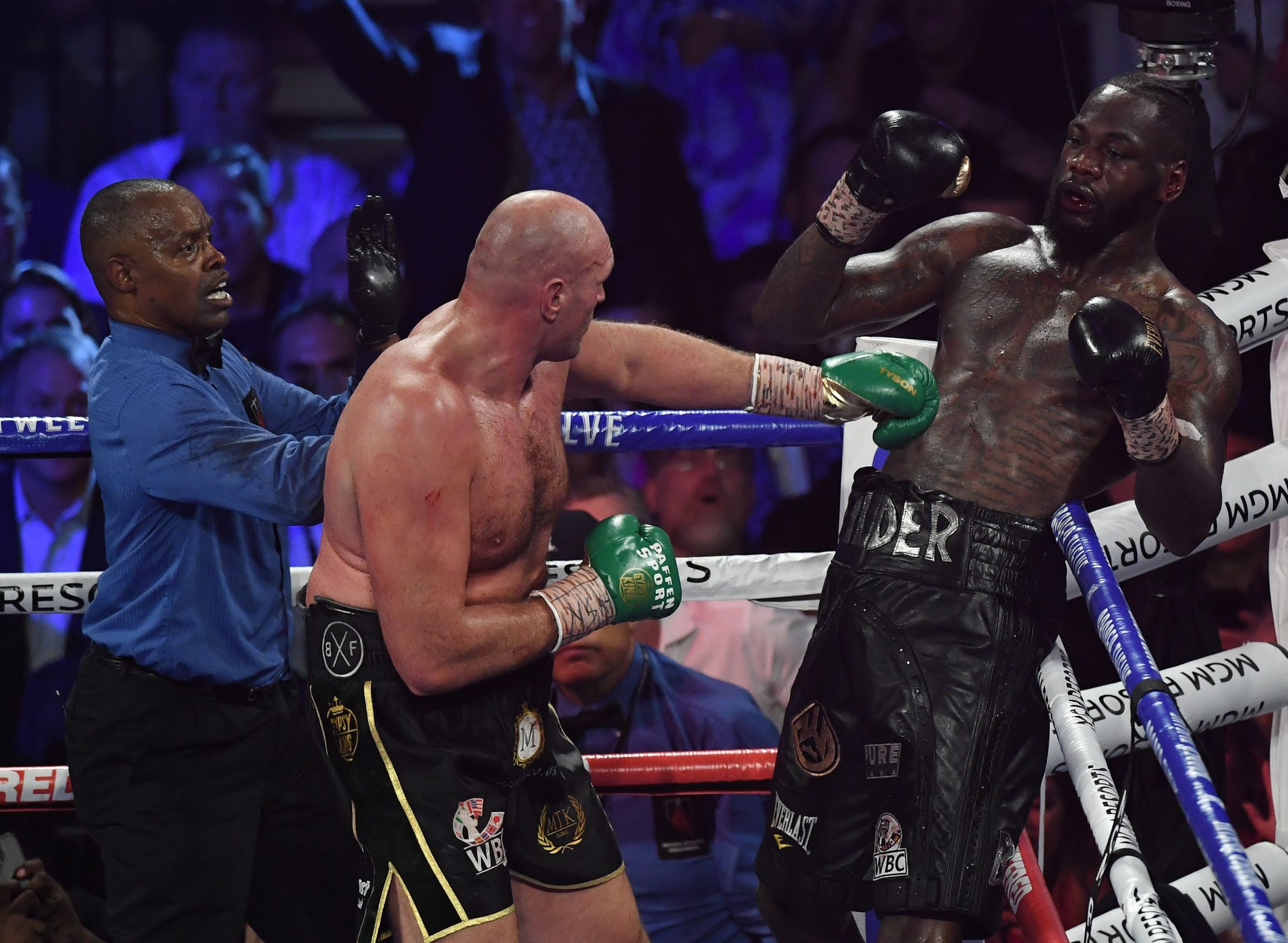 Referee Kenny Bayless stops the fight after the towel was thrown in by Wilder's trainer as British boxer Tyson Fury (L) defeats US boxer Deontay Wilder in the seventh round during their World Boxing Council (WBC) Heavyweight Championship Title boxing match at the MGM Grand Garden Arena in Las Vegas on February 22, 2020. (Photo by Mark RALSTON / AFP)