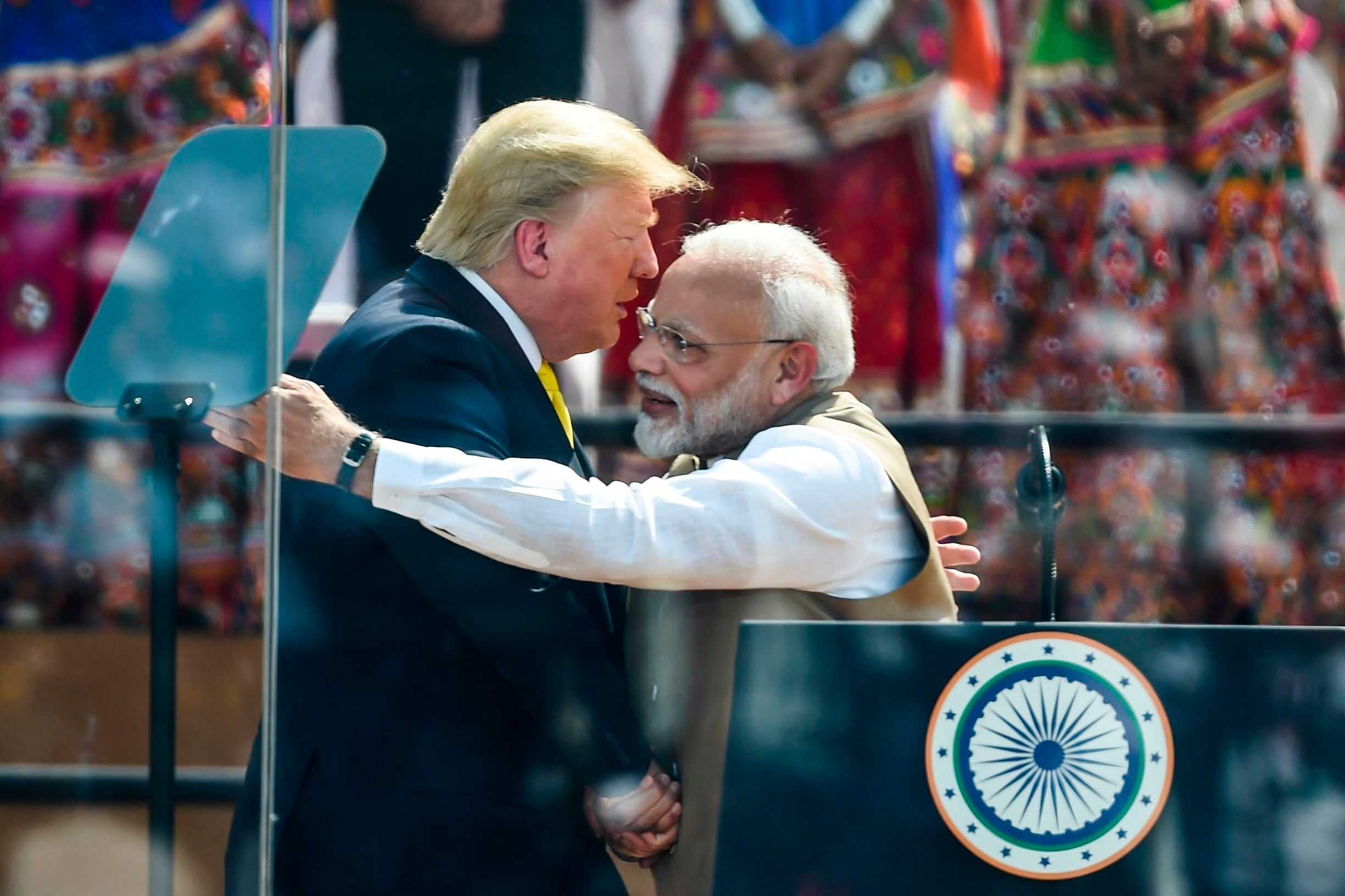 US President Donald Trump shakes hands with India's Prime Minister Narendra Modi during 'Namaste Trump' rally at Sardar Patel Stadium in Motera, on the outskirts of Ahmedabad, on February 24, 2020. (Photo by Money SHARMA / AFP)